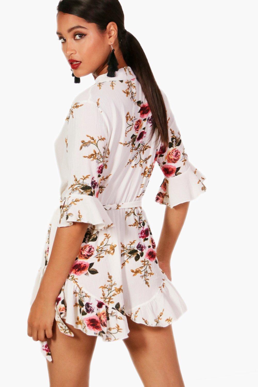 691e5476b47 ... Wrap Floral Ruffle Hem Playsuit - Lyst. View fullscreen