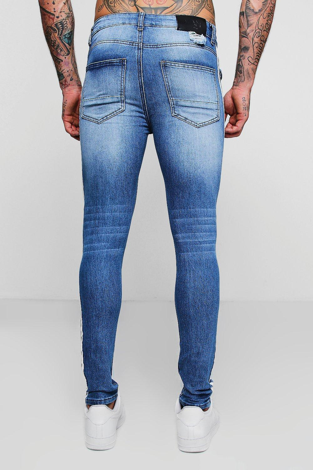 52036776ccf67 ... Skinny Distressed Jeans With Side Tape for Men - Lyst. Visit boohooman.  Tap to visit site