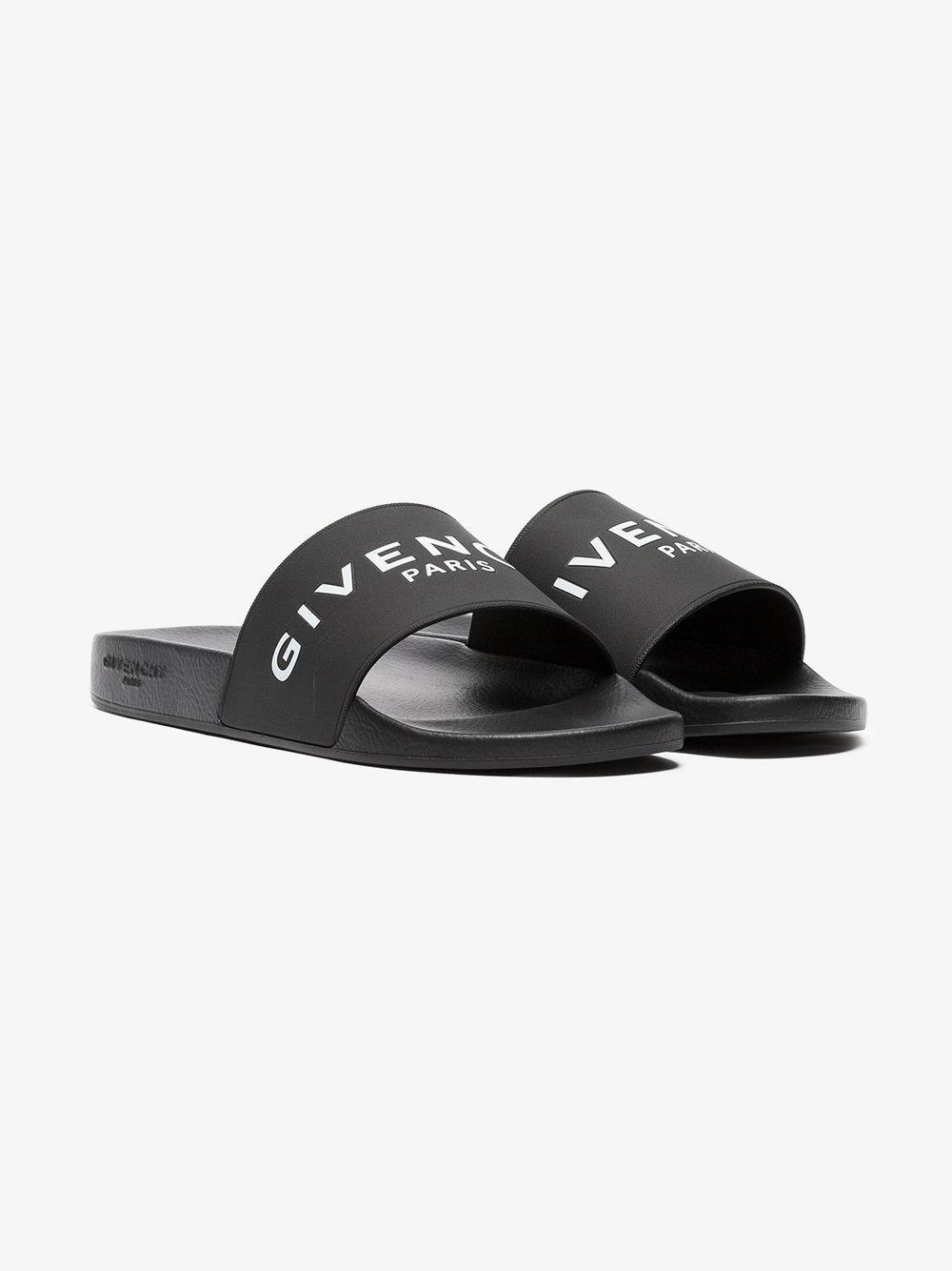 d44f7bae54c7 Givenchy Black And White Paris Logo Rubber Slides in Black for Men ...