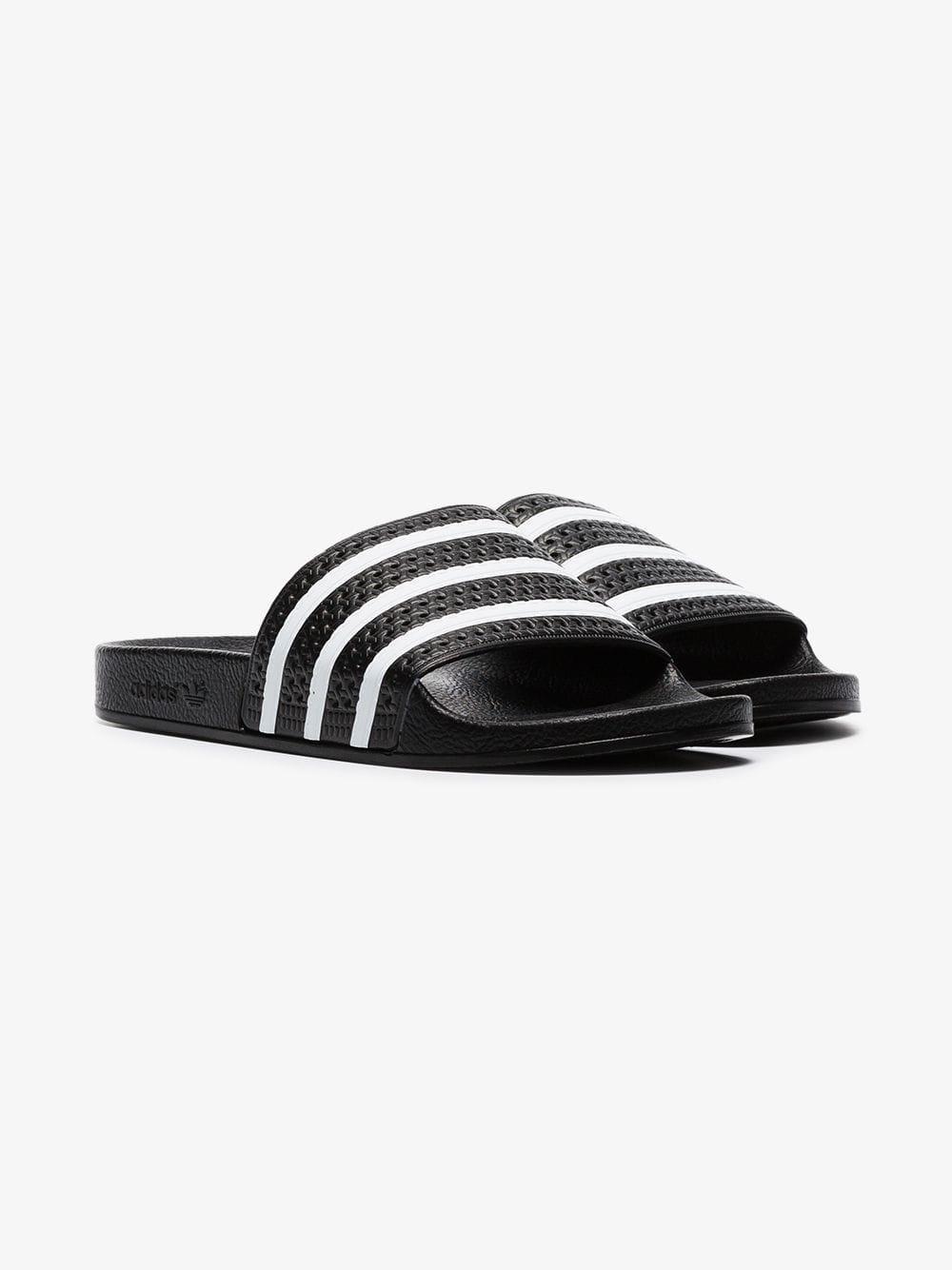 1af200803ea87f Adidas - Black And White Adilette Slides for Men - Lyst. View fullscreen