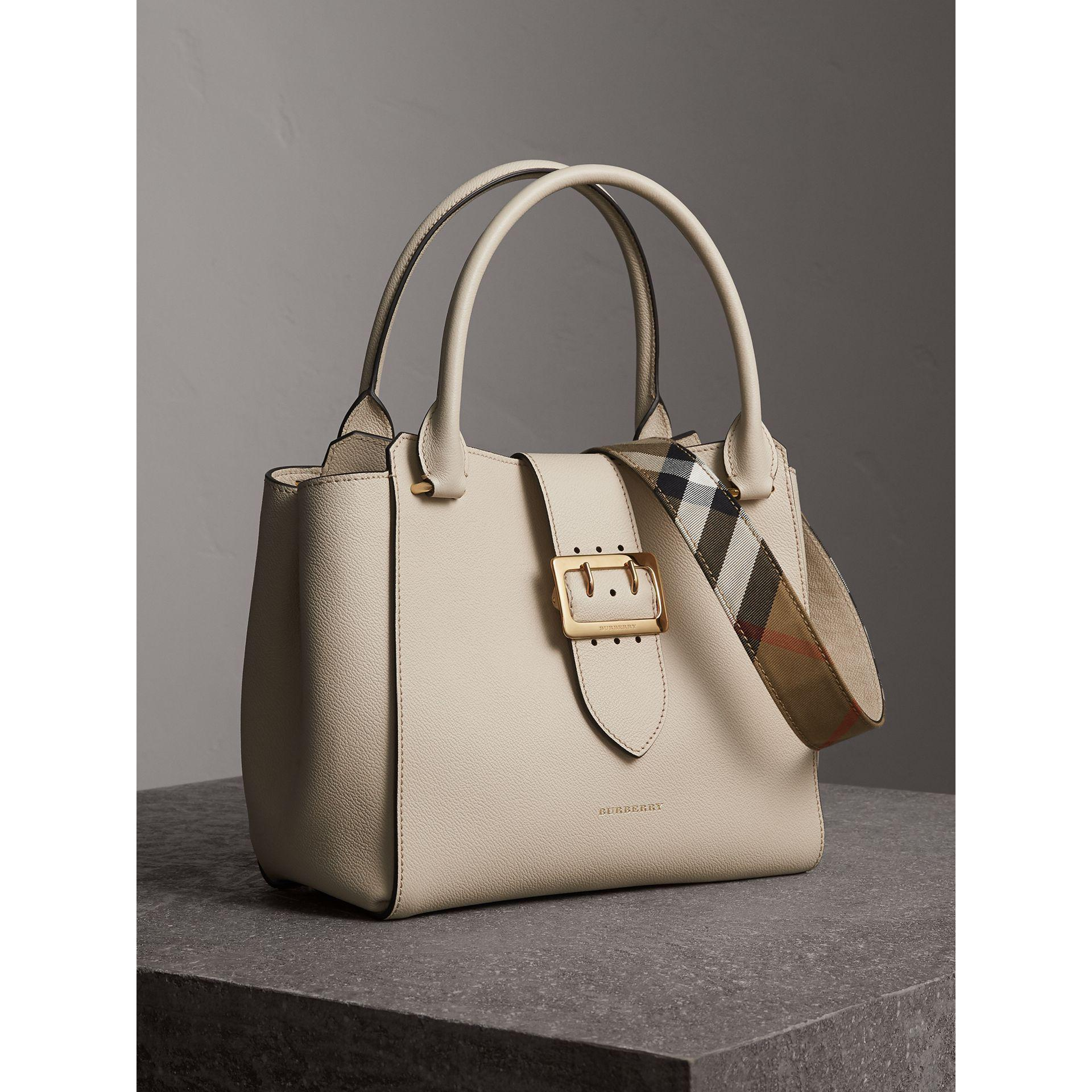 5d46fb9f500f Lyst - Burberry The Medium Buckle Tote In Grainy Leather Limestone