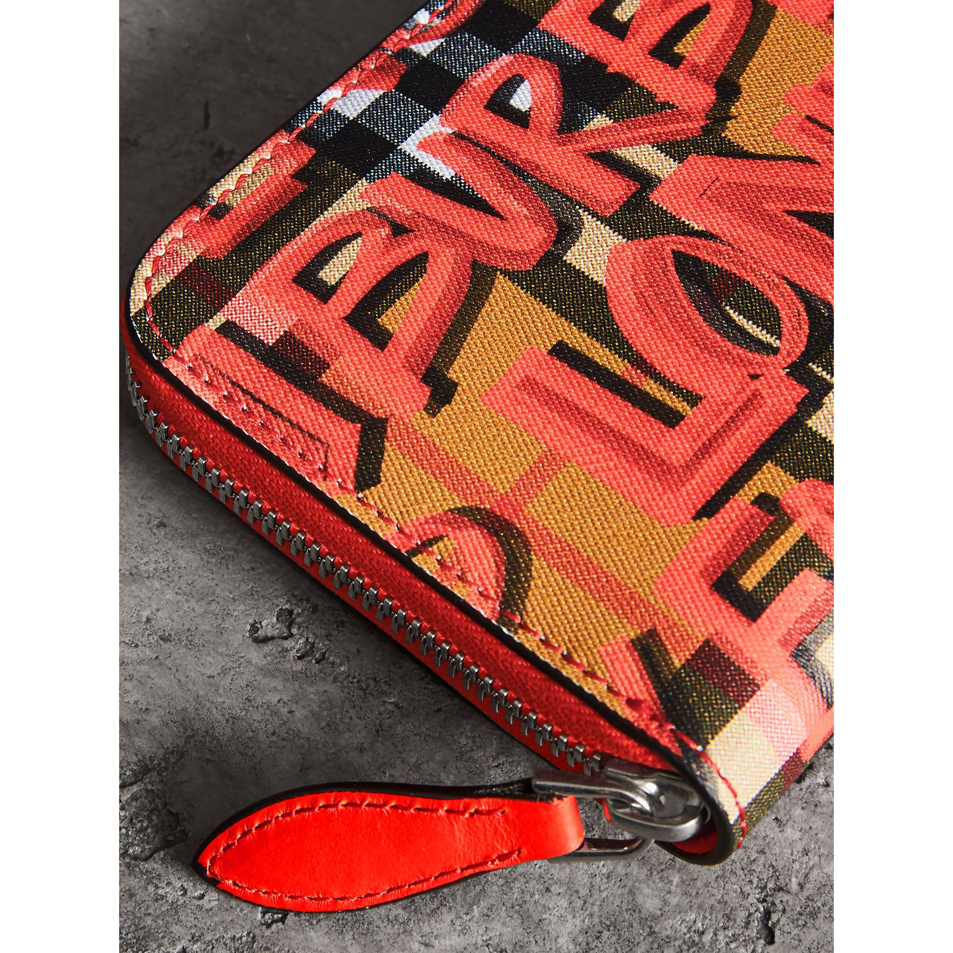 111263fd393 Burberry - Red Graffiti Print Vintage Check Leather Ziparound Wallet -  Lyst. View fullscreen