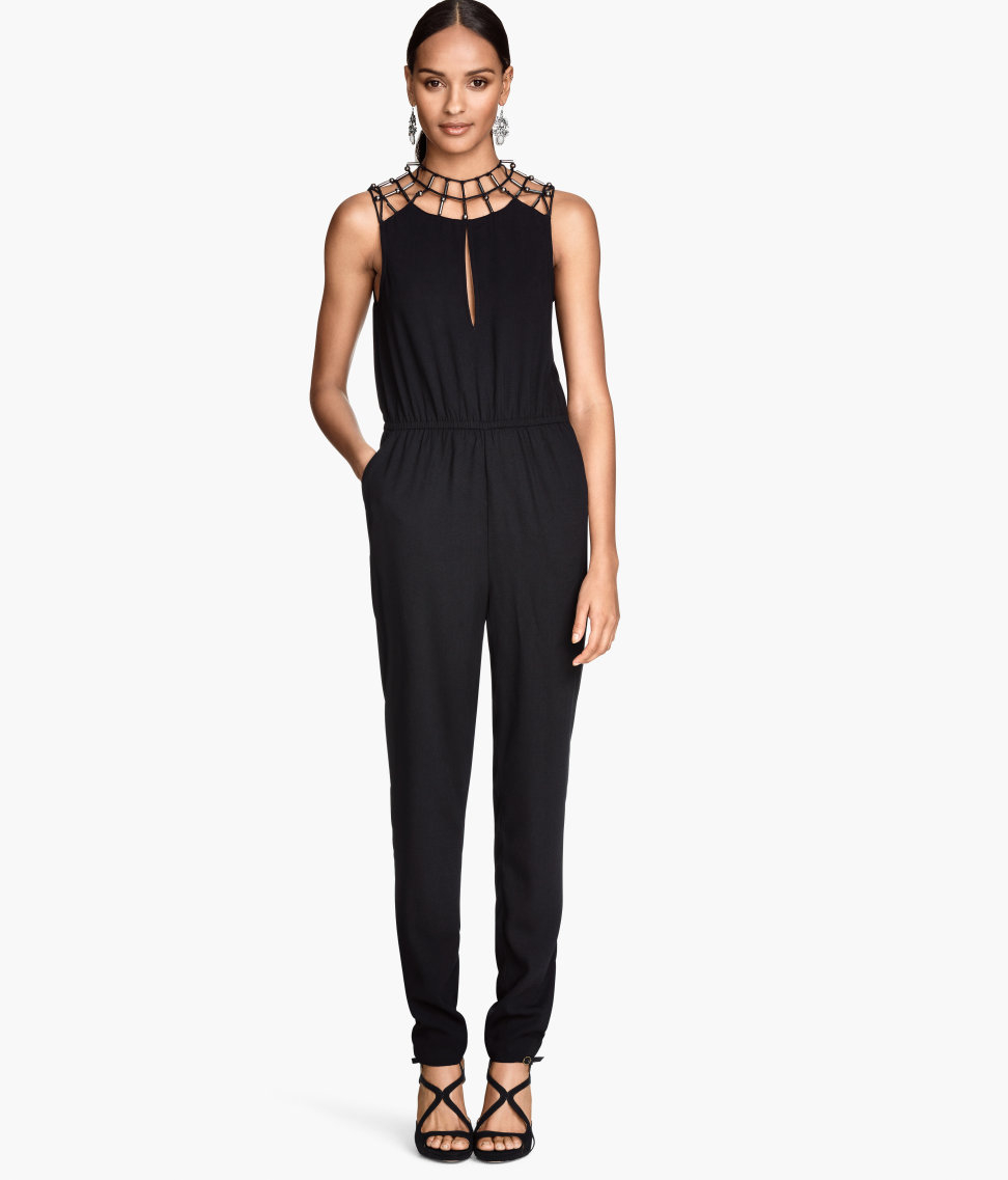 Jumpsuit in crêped, woven fabric with a wrapover top, short, wide sleeves, and seam at waist with elastication at back. Removable tie belt, side pockets, and short legs.