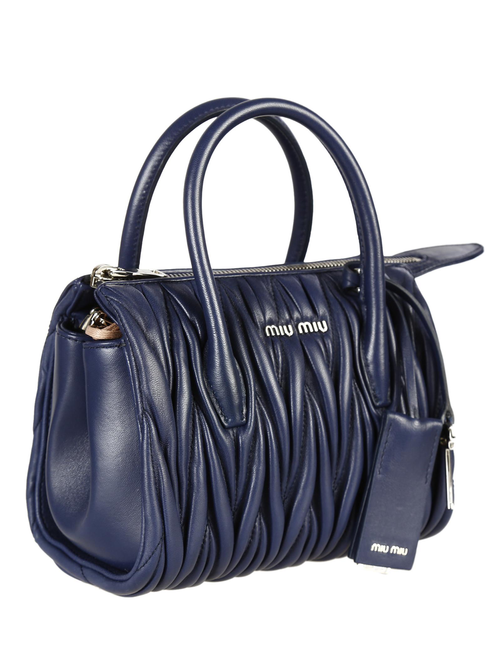 Miu Miu Matelasse Leather Top Handle Bag In Blue
