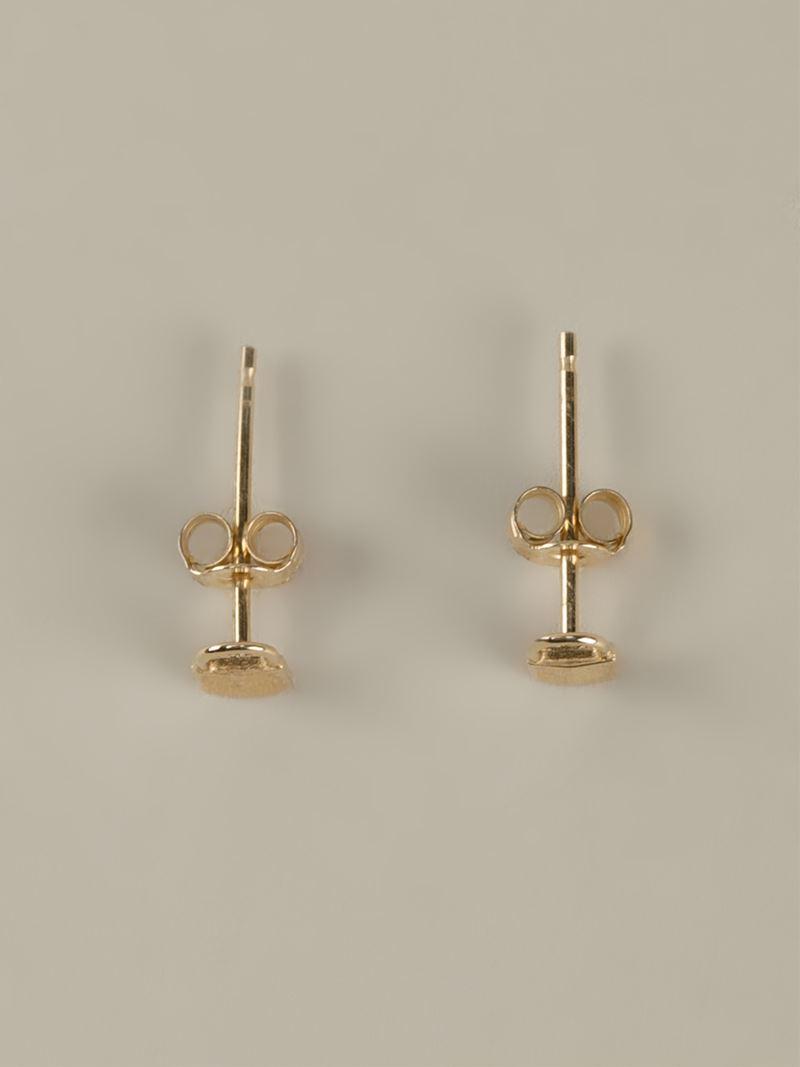 klassen tiny padlock earrings in metallic lyst