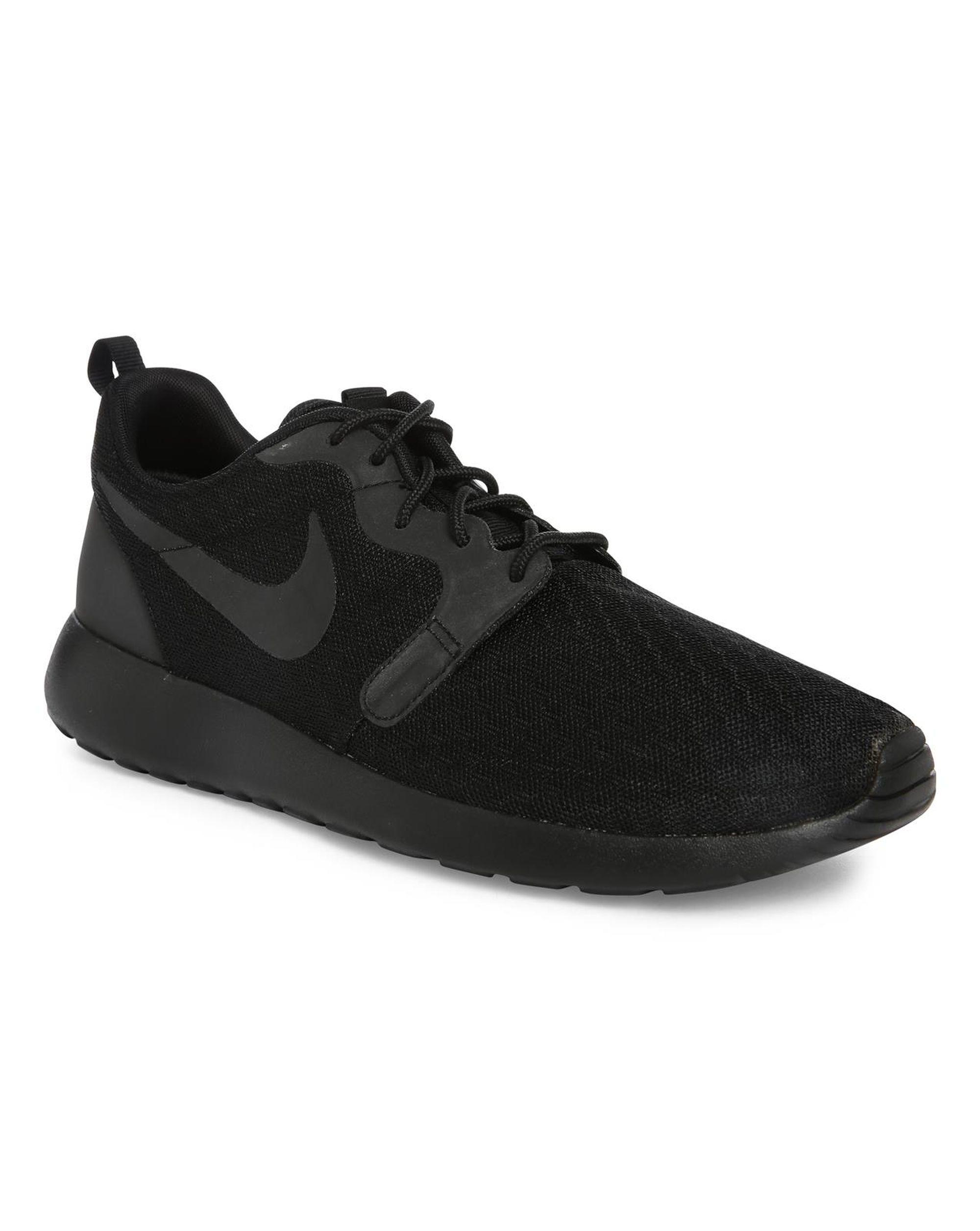 nike black roshe one hyp mono sneakers in black for lyst