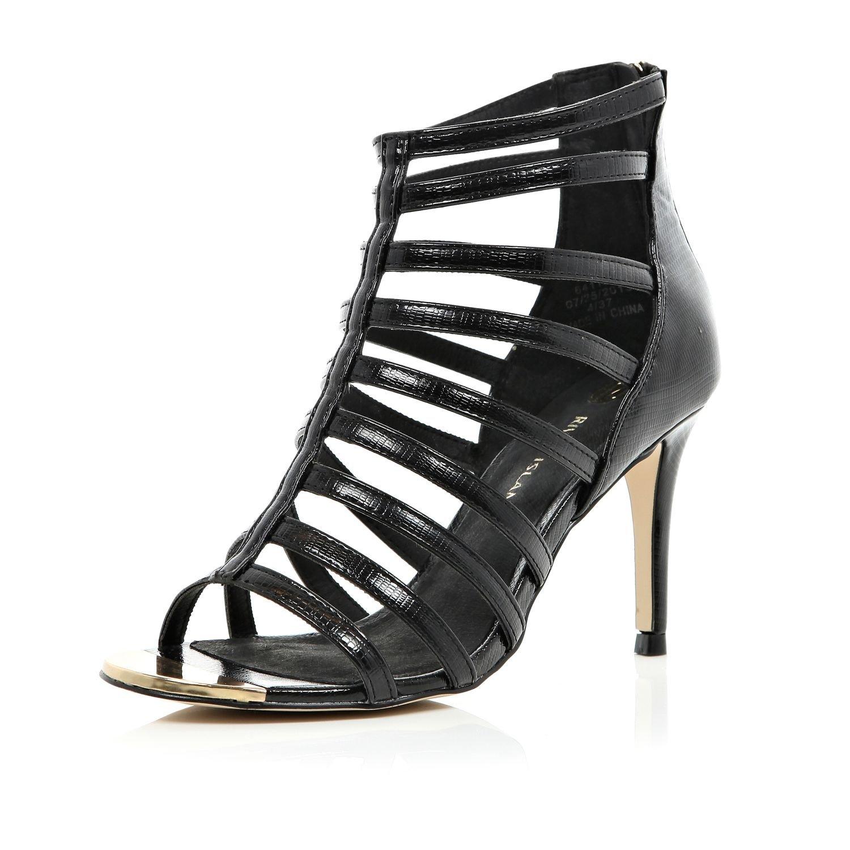 4d8f48fd1b7c River Island Black Mid Heel Gladiator Sandals in Black