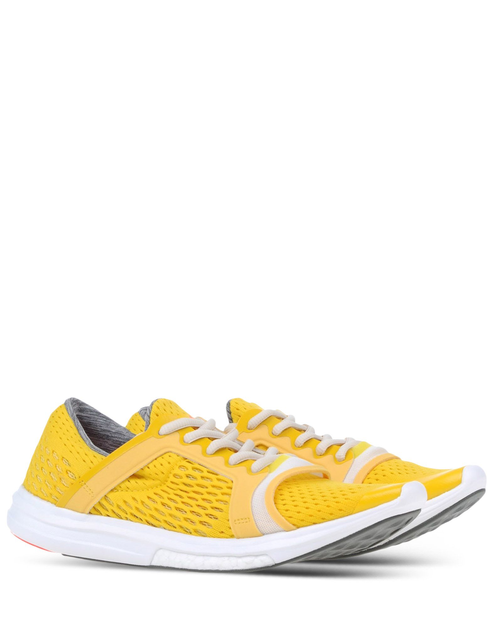 adidas by stella mccartney low tops trainers in yellow. Black Bedroom Furniture Sets. Home Design Ideas