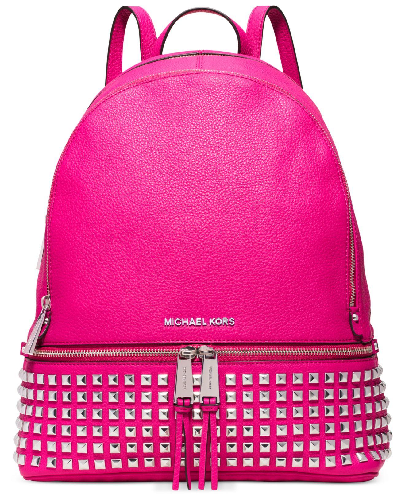 020c701b90c ... discount lyst michael kors michael rhea zip large studded backpack in  pink e218c 12fba
