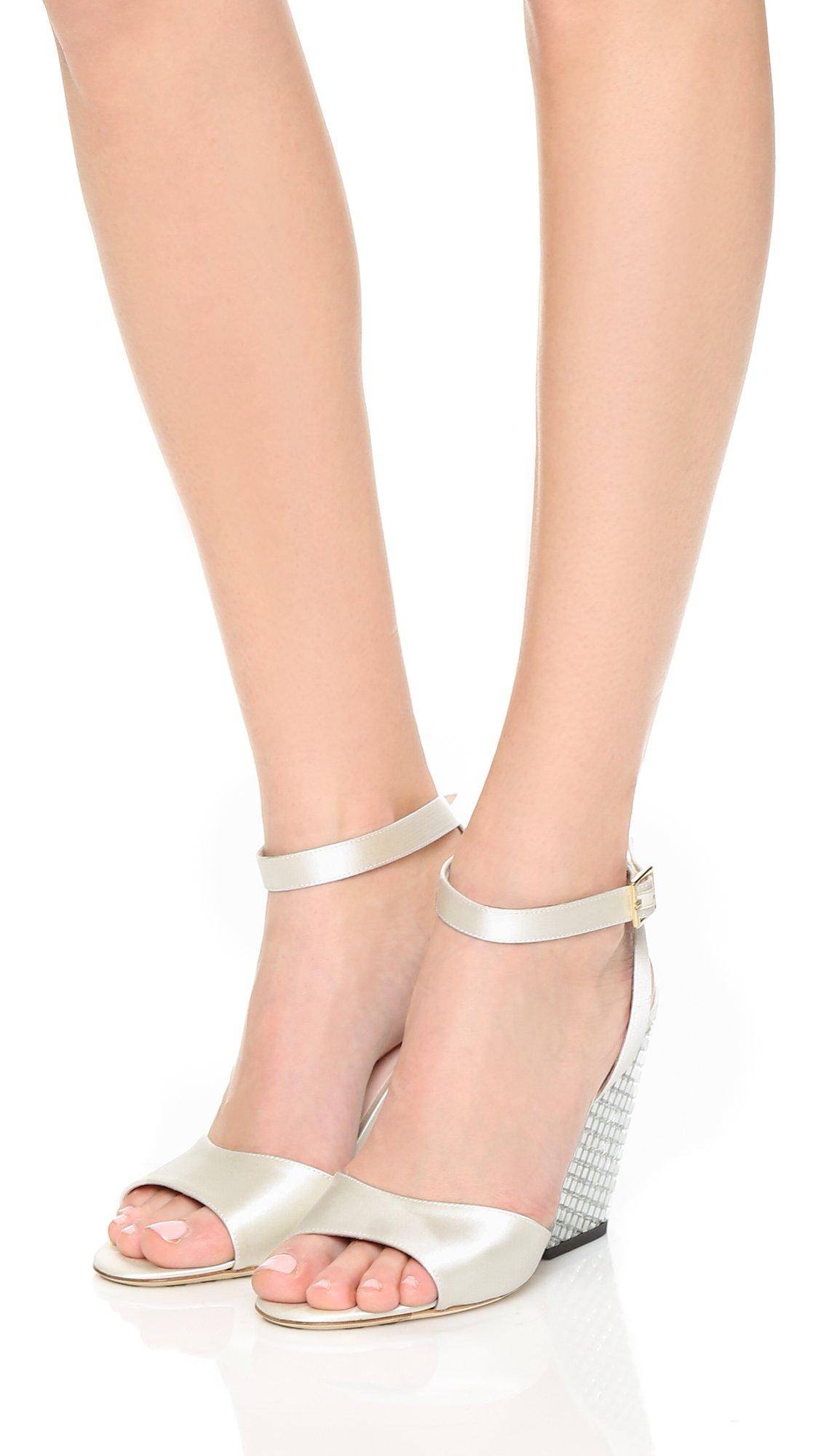 2303aae2ff22 Lyst - Kate Spade Isadora Wedges in White