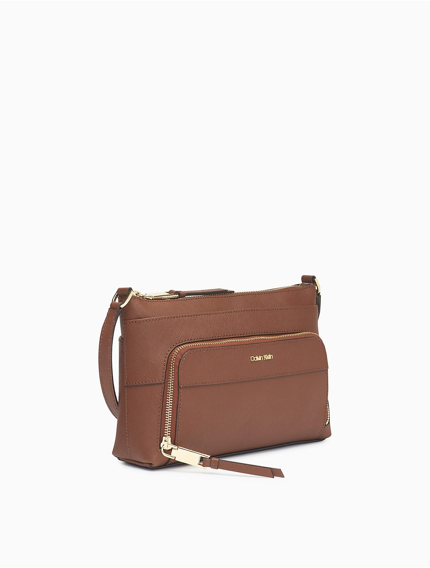 Lyst - Calvin Klein Saffiano Crossbody Bag in Brown d83b925675