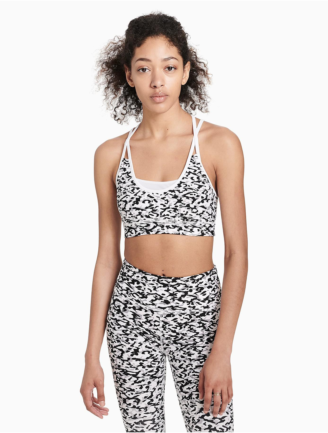 2520cc6427 Lyst - Calvin Klein Performance Printed Racerback Sports Bra in Black
