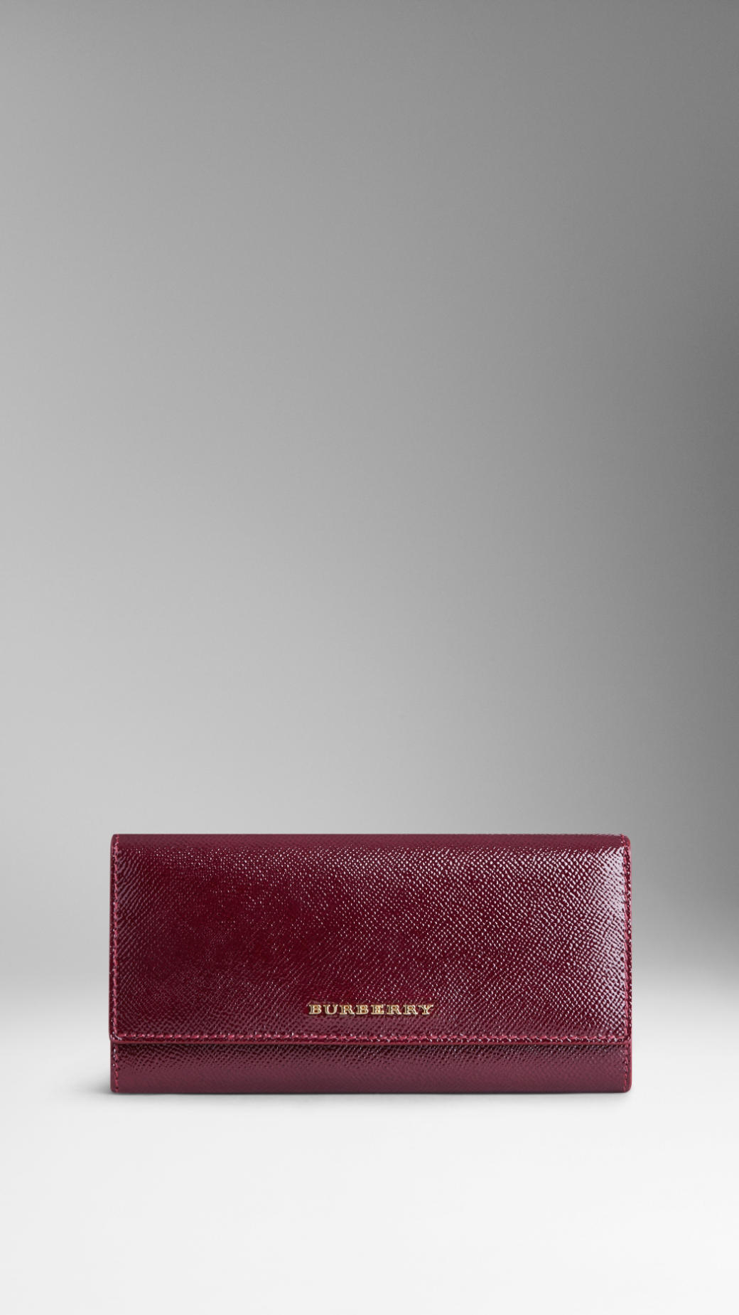 748fa317483c Lyst - Burberry Patent London Leather Continental Wallet in Red