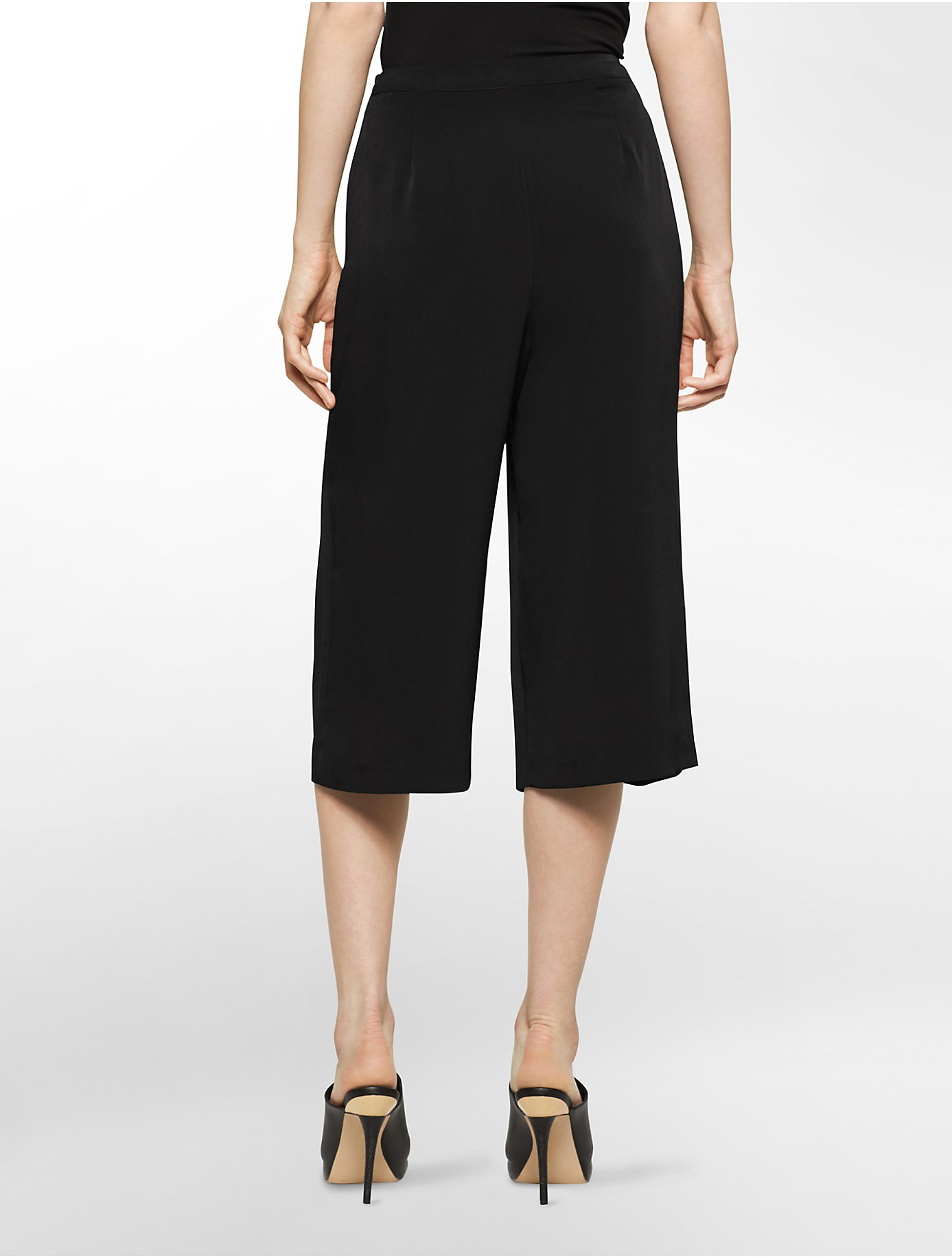 lyst calvin klein white label pleated front culotte pants in black. Black Bedroom Furniture Sets. Home Design Ideas