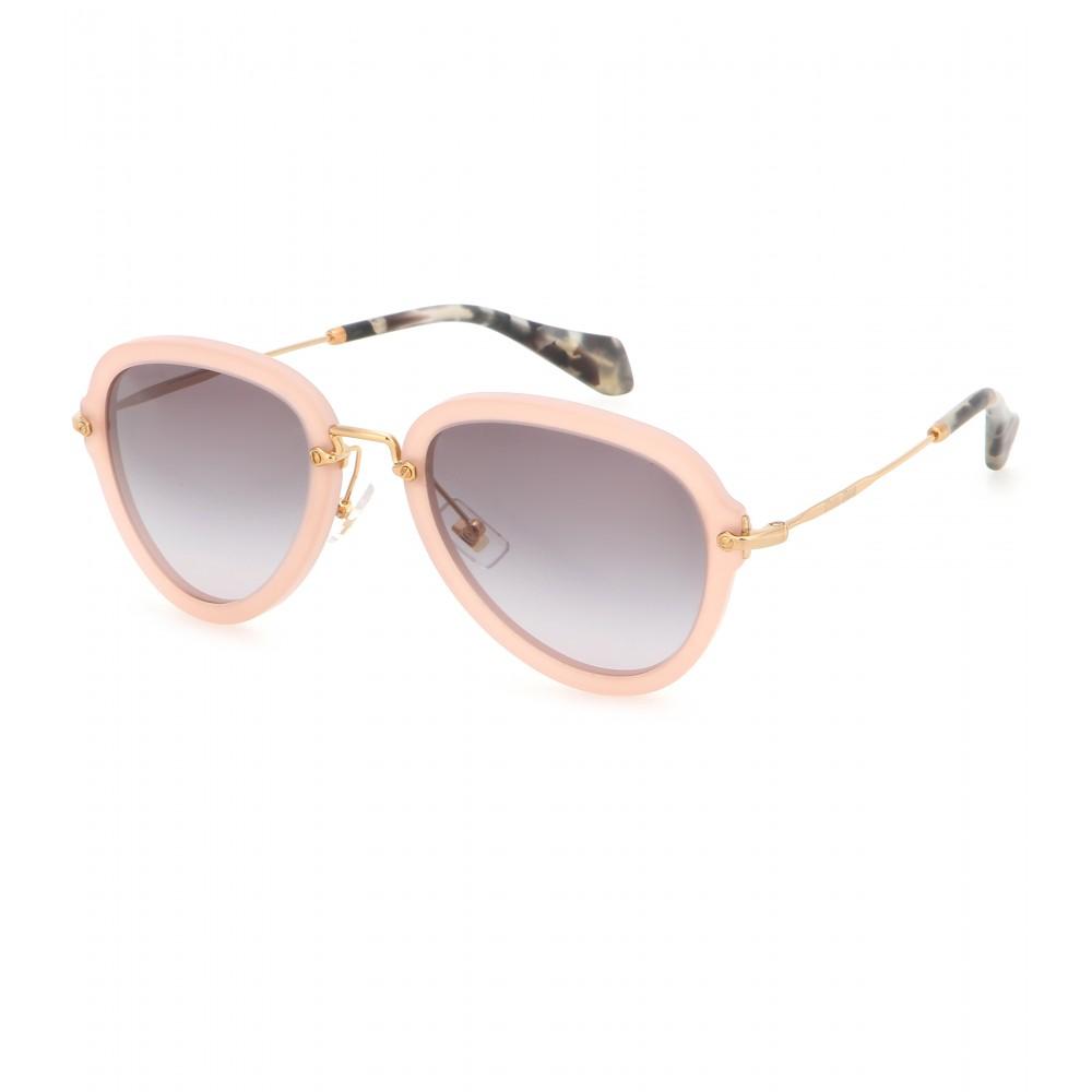 1817cd487086 Miu Miu Aviator Sunglasses in Natural - Lyst