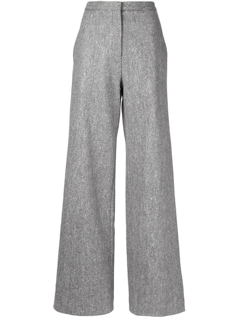 The Estie trousers in grey are a feminine take on a traditionally tailored design. They are cut to a wide-leg silhoutte with a high rise, offering a distinclty retro feel that's sure to make a statement.