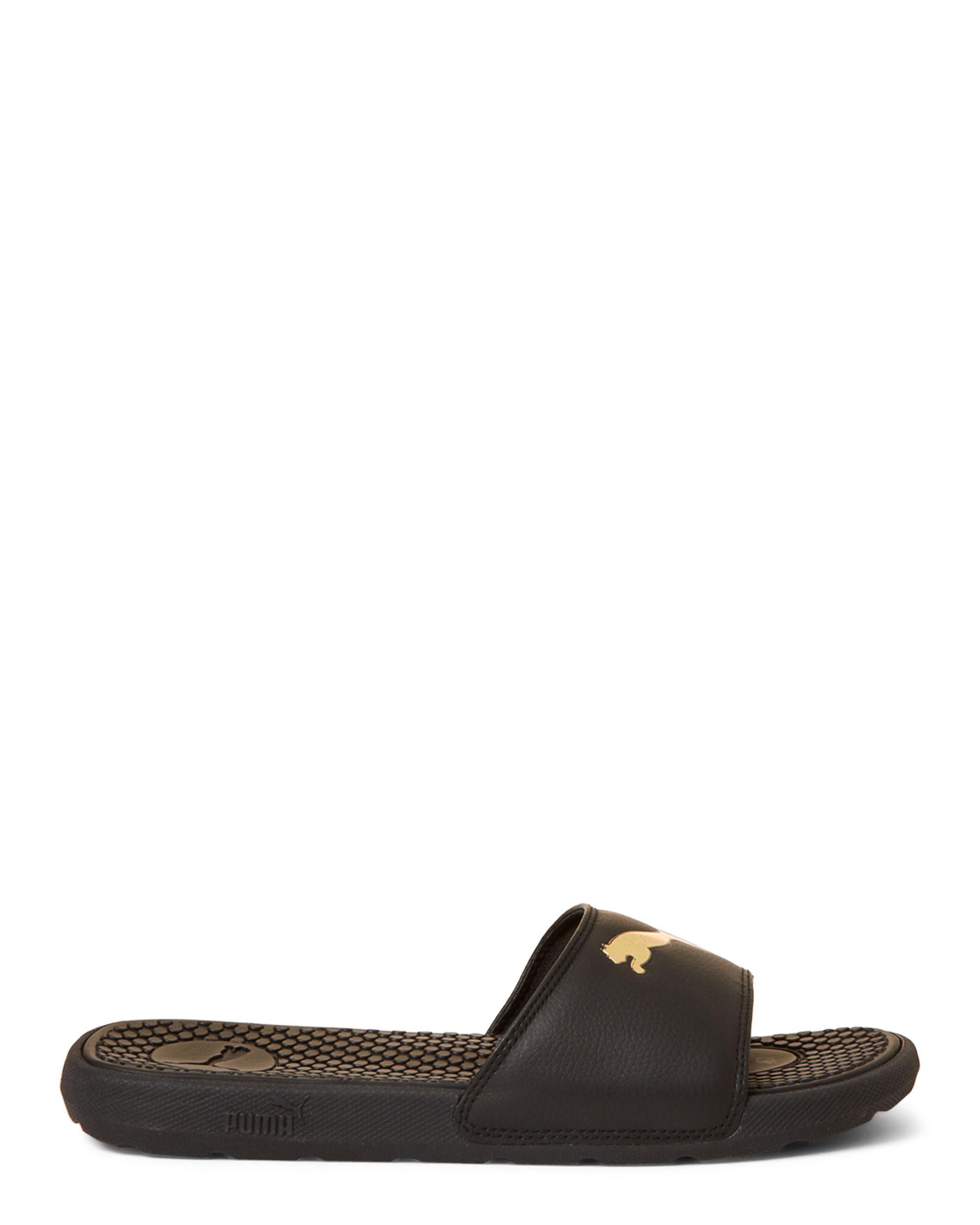 bc1c177de Lyst - PUMA Black   Gold Cool Cat Sport Slide Sandals in Black