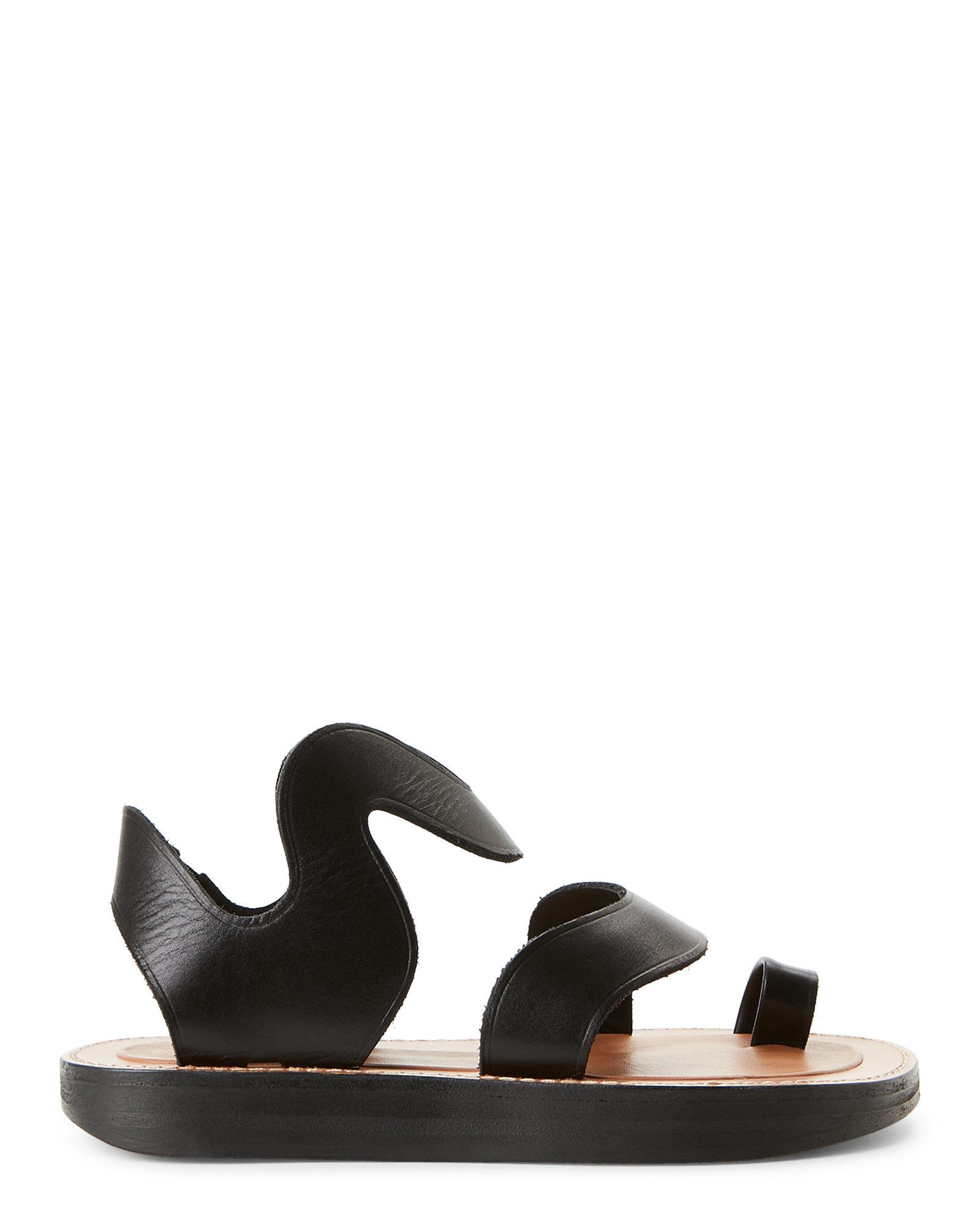 79cdaea162db97 Lyst - Céline Black Wave-Strap Toe Ring Flat Sandals in Black
