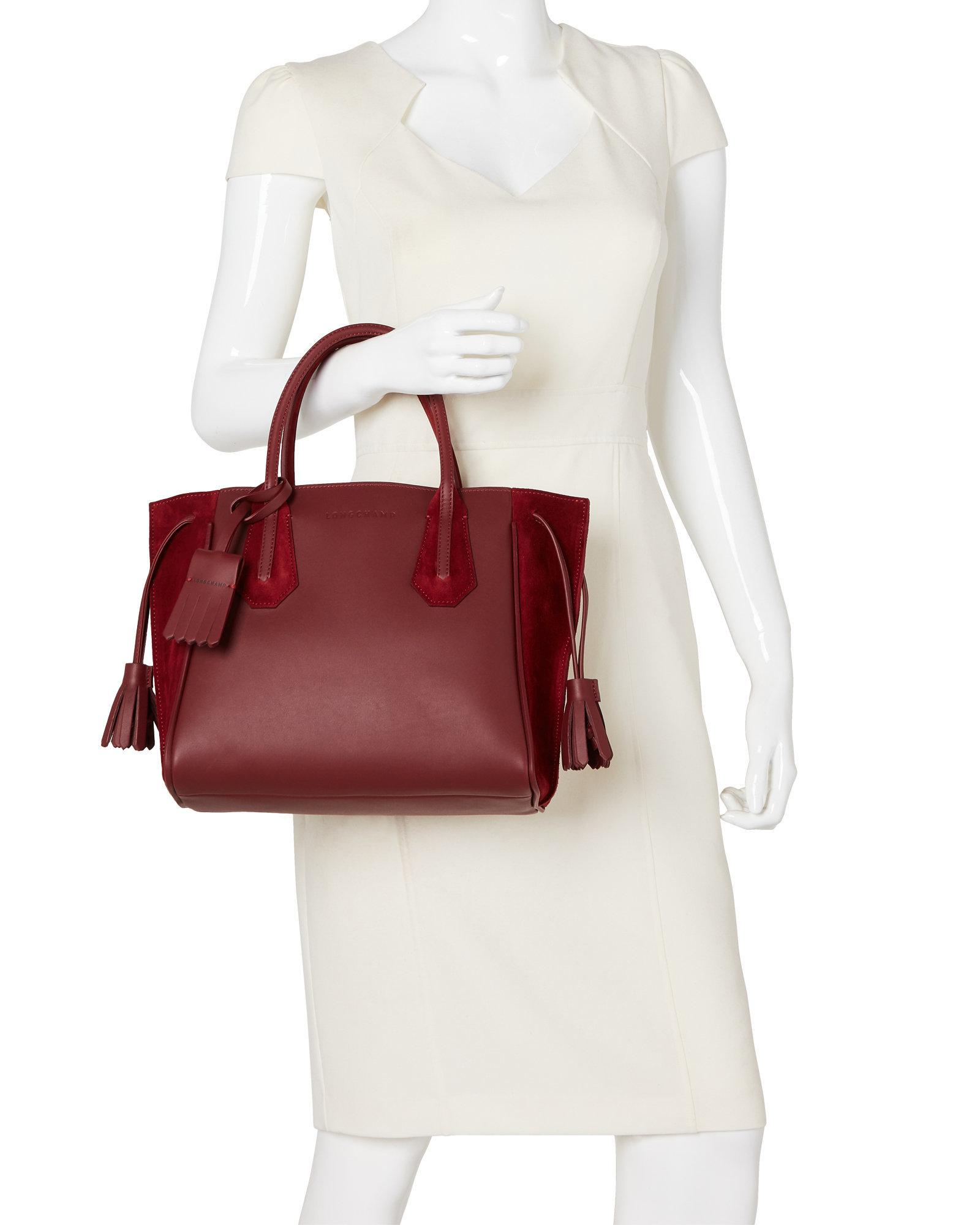 7f3ba5aa02c8 Lyst - Longchamp Burgundy Penelope Small Tote in Red