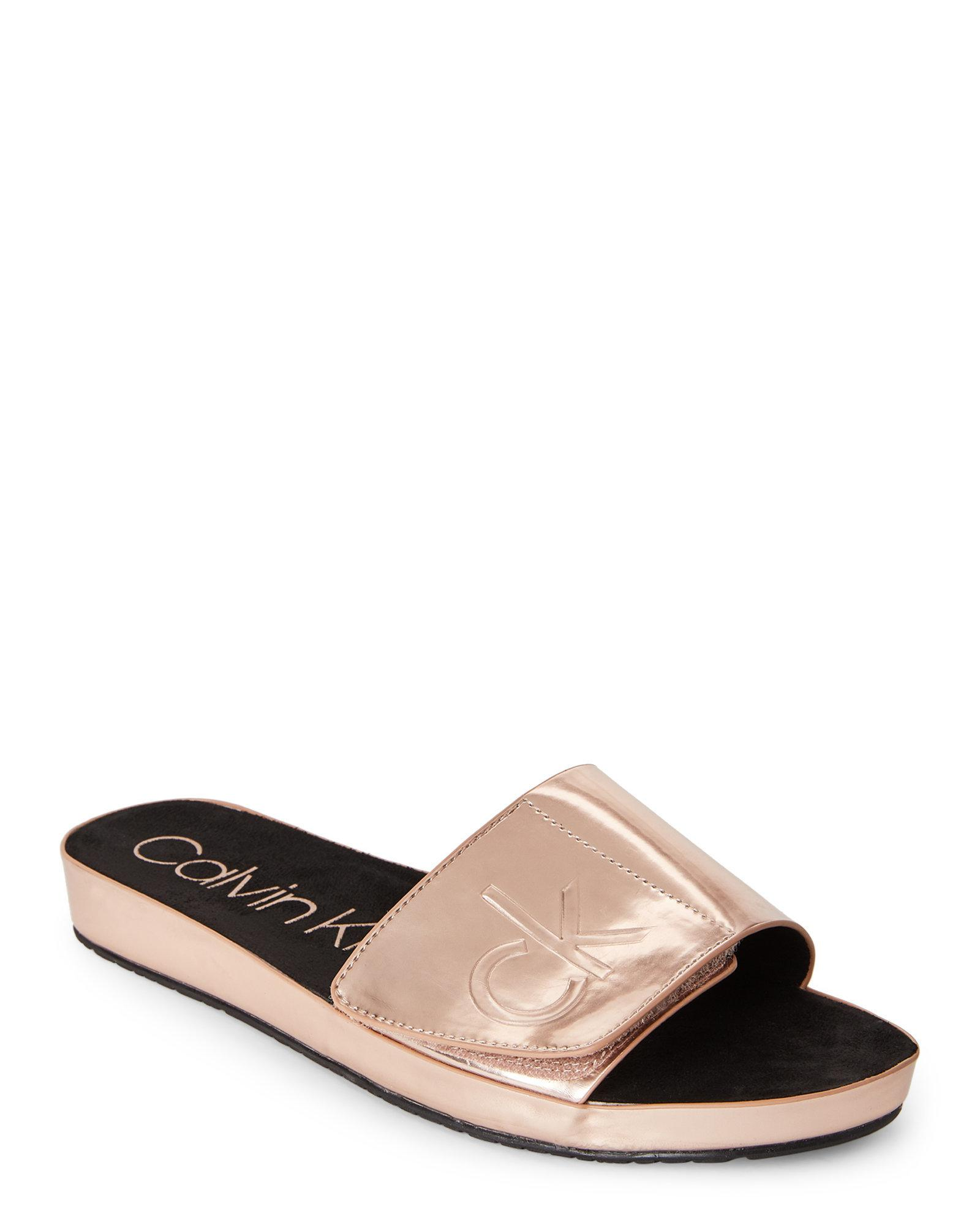 7cb580116bff8 CALVIN KLEIN 205W39NYC Rose Gold Marlina Metallic Slide Sandals