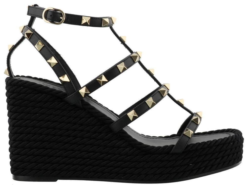 7eb3666aa78e0 Valentino Garavani Rockstud Wedge Sandals in Black - Lyst