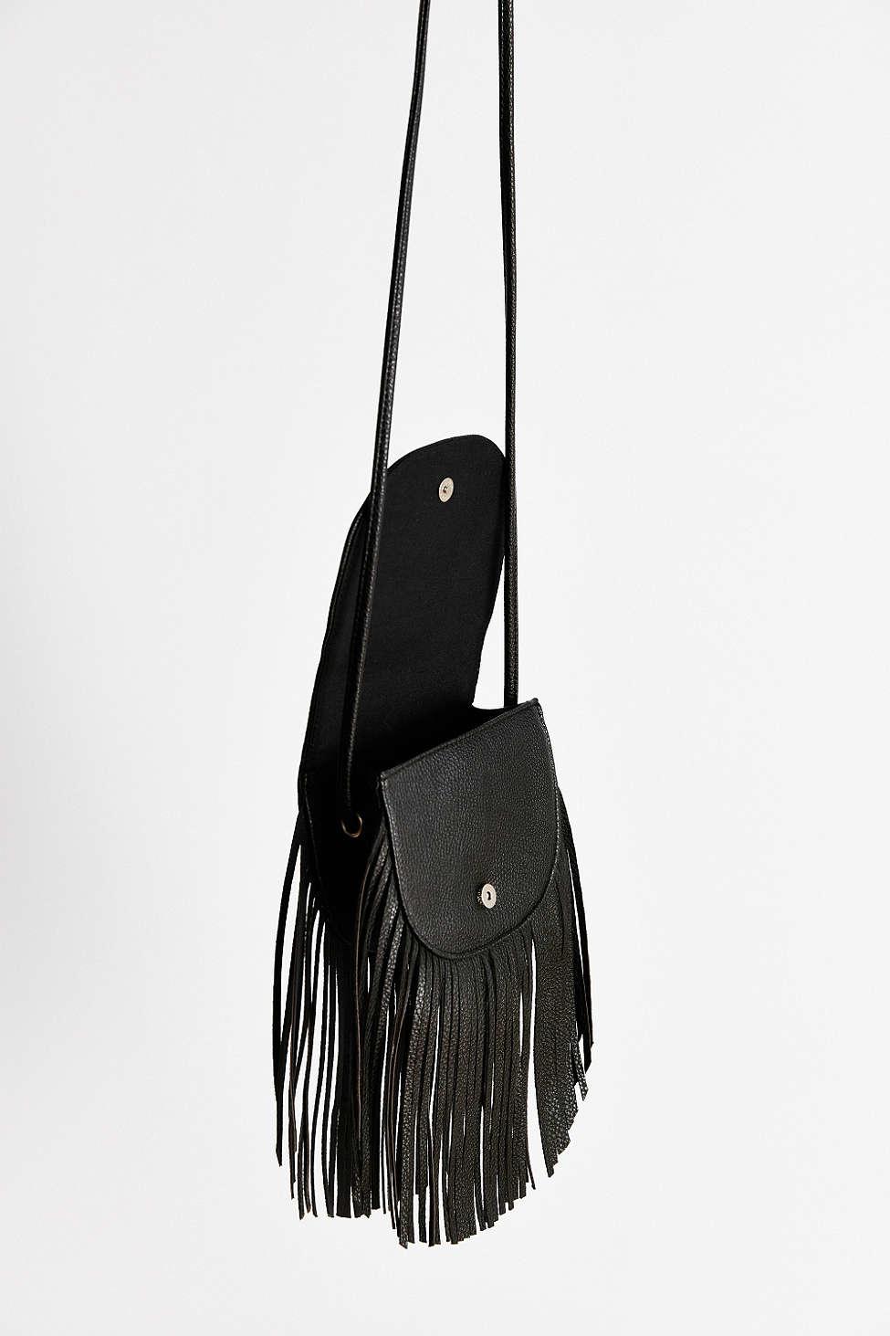 ecote fringe saddle bag in black lyst