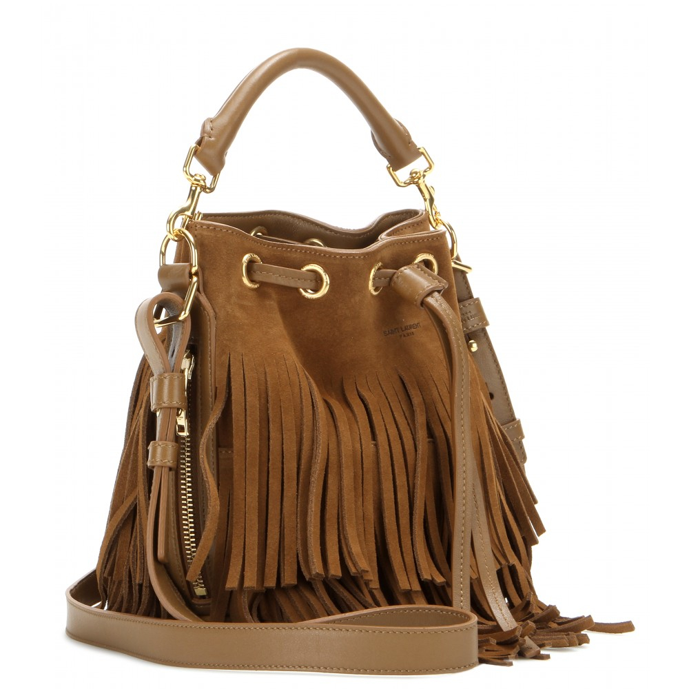 Description. A stylish suede cross body bag coming in a standout rustic brown. With tassels running down the sides it will be the perfect finish for any boho outfit - whether it's a classic denim shorts and crochet combo or a simple pair of harem pants and a tee.