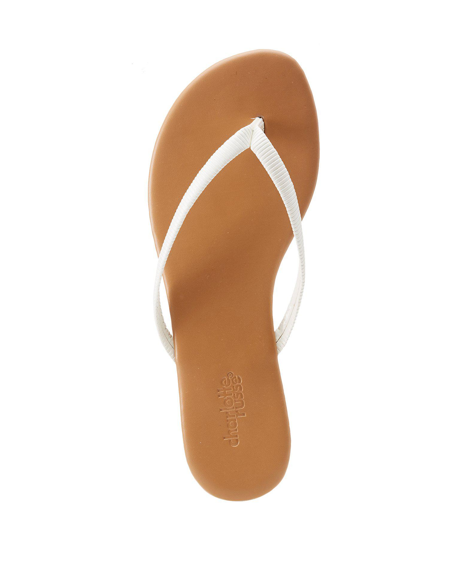 89390e3ed9a1 Lyst Charlotte Russe Faux Patent Leather Flip Flops In White