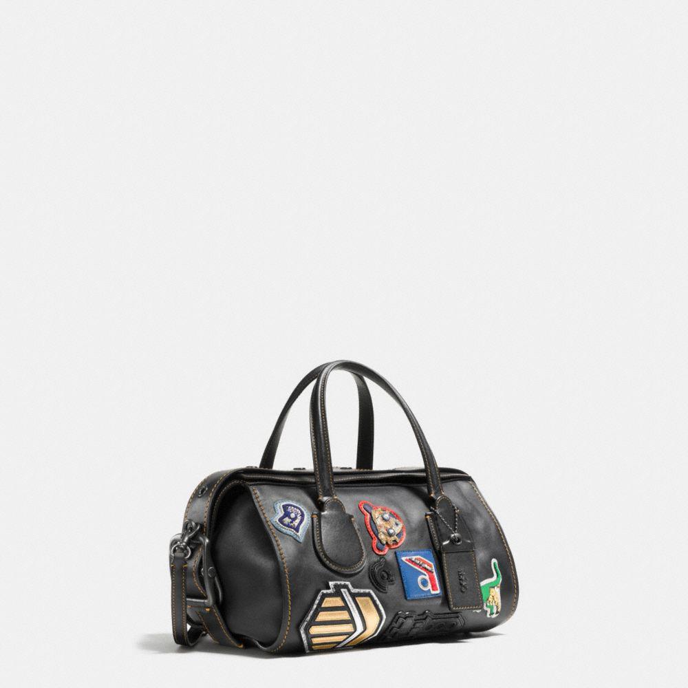 3b51496e36475 ... czech lyst coach badlands satchel with varsity patch in black 96d1c  0e124