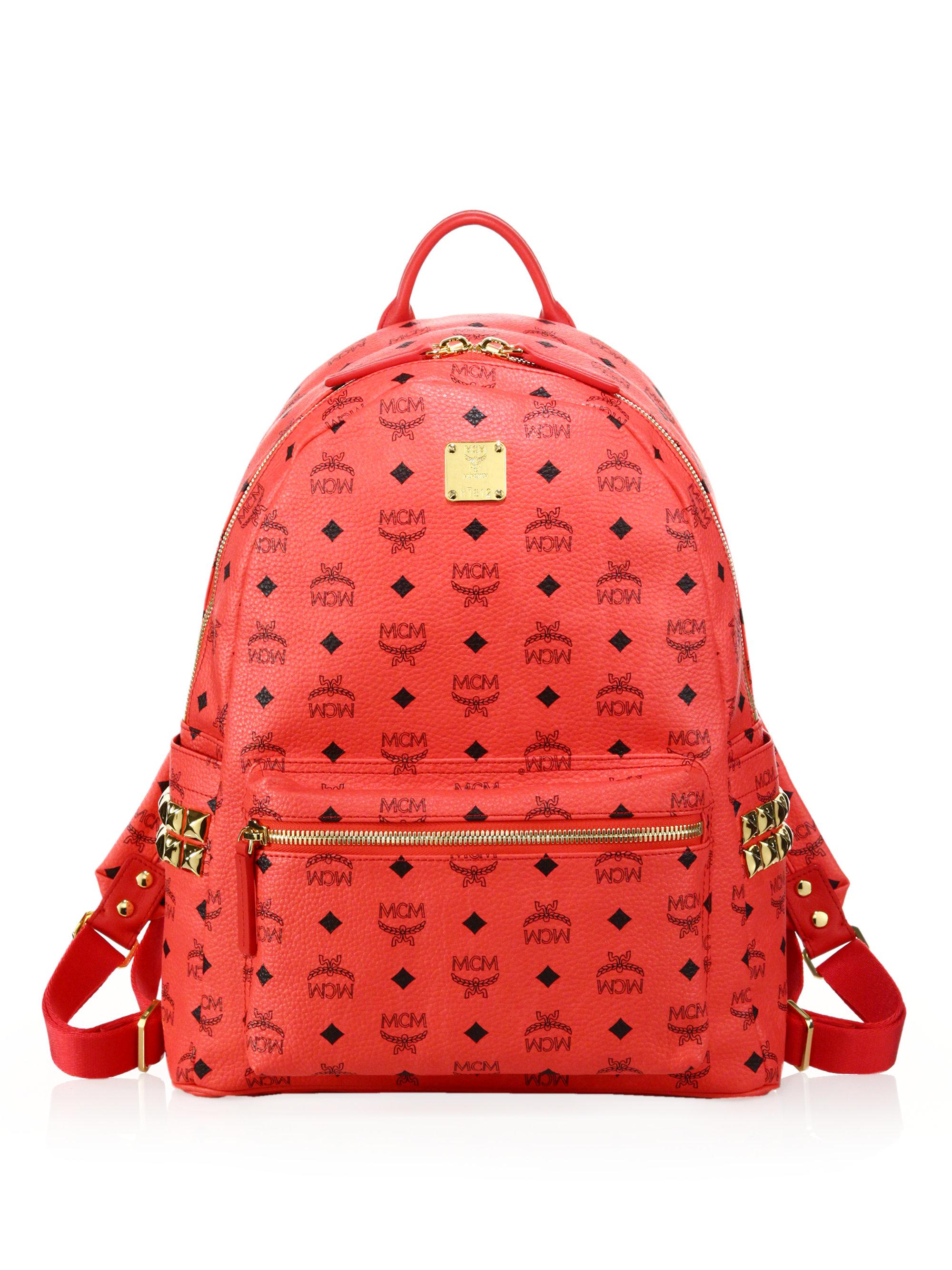 mcm stark side studded coated canvas monogram backpack in red for men lyst. Black Bedroom Furniture Sets. Home Design Ideas