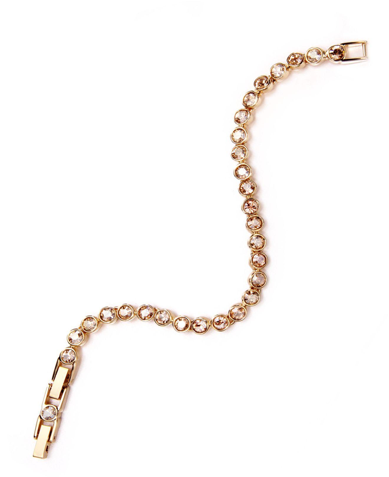 swarovski golden shadow crystal tennis bracelet in. Black Bedroom Furniture Sets. Home Design Ideas