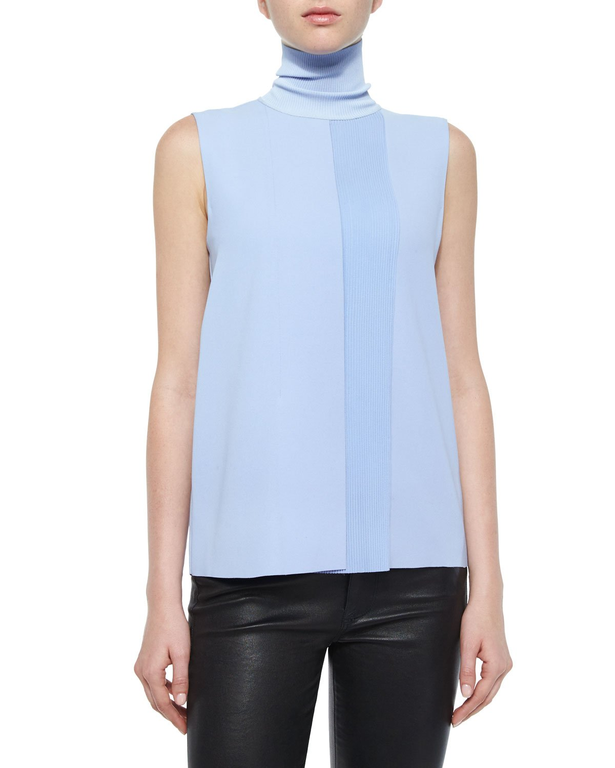 Similarly, a cropped sleeveless turtleneck can be distinctly casual when made from cotton and paired with jeans or shorts, but be decidedly upscale and edgy when incorporated into a more tailored, structured look with higher-end fabrics, like silk or cashmere.