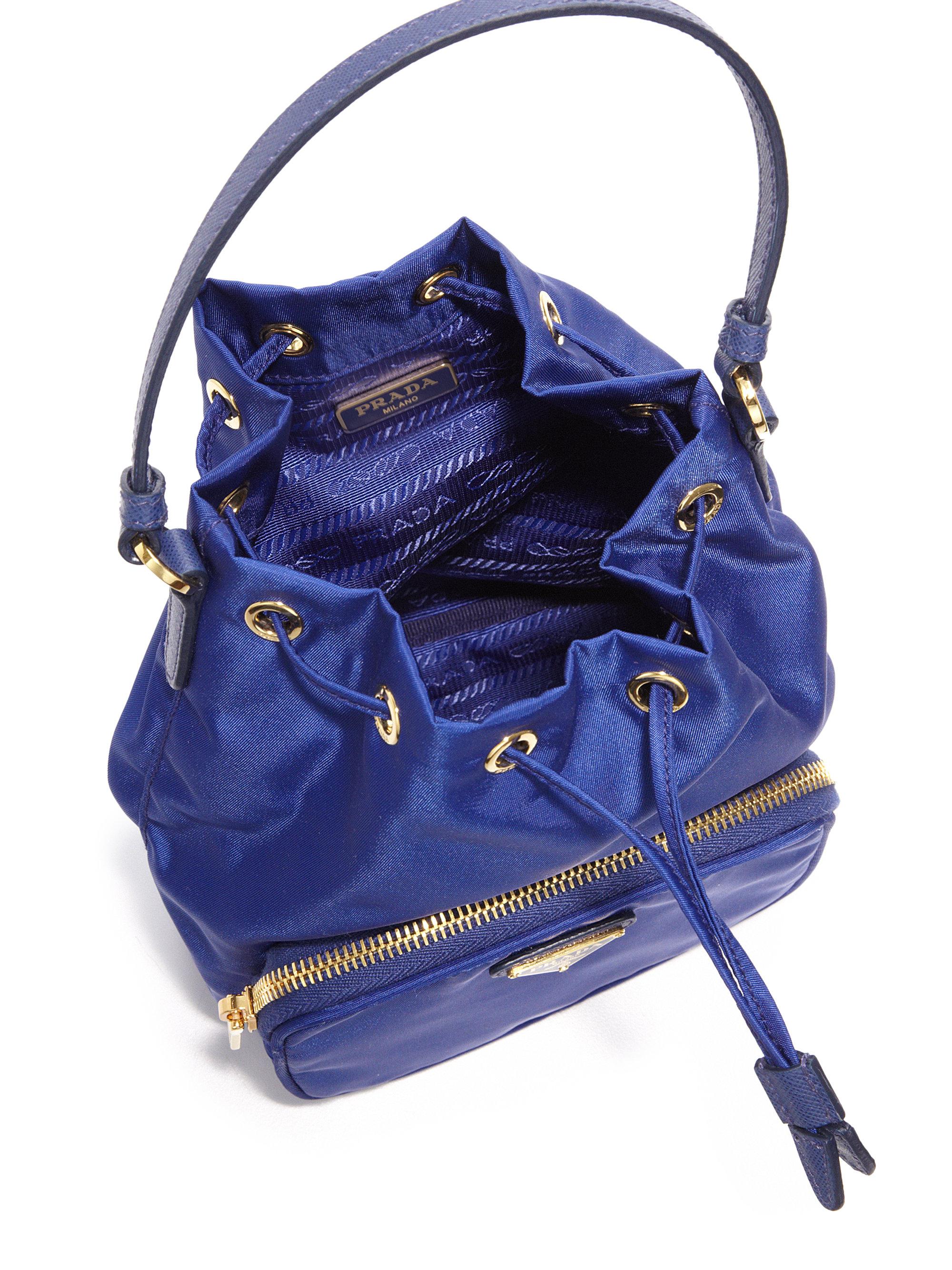 3b3bd31bd197 ... france lyst prada mini nylon and leather bucket bag in blue 22fd4 b9549