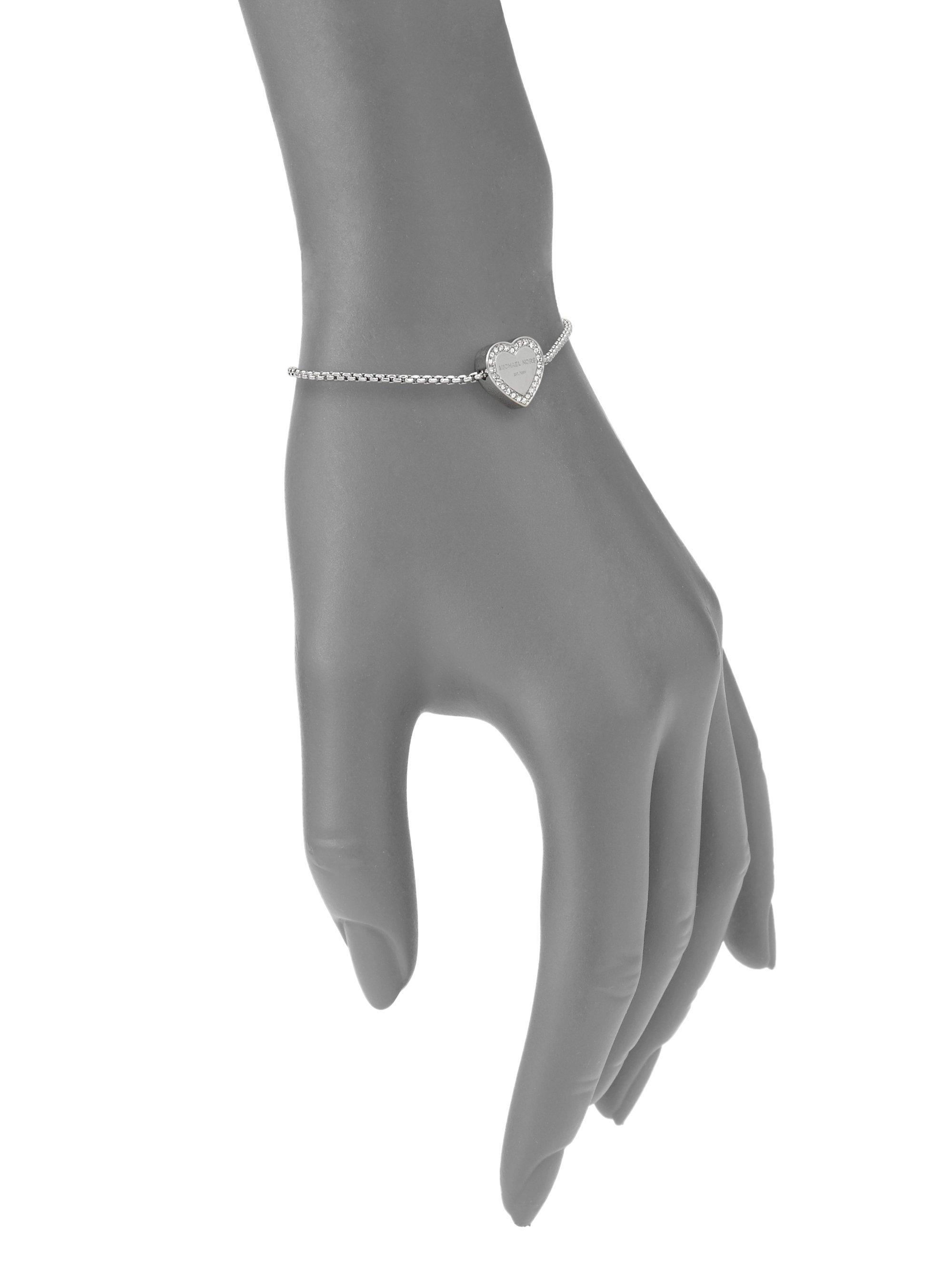 f8527ea3e7cae Lyst - Michael Kors Heritage Pave Logo Heart Slide Bracelet in Metallic