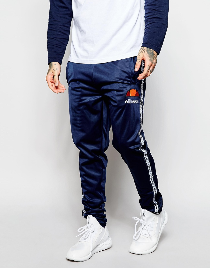 9c1fdae1 Ellesse Blue Track Pants With Taping for men