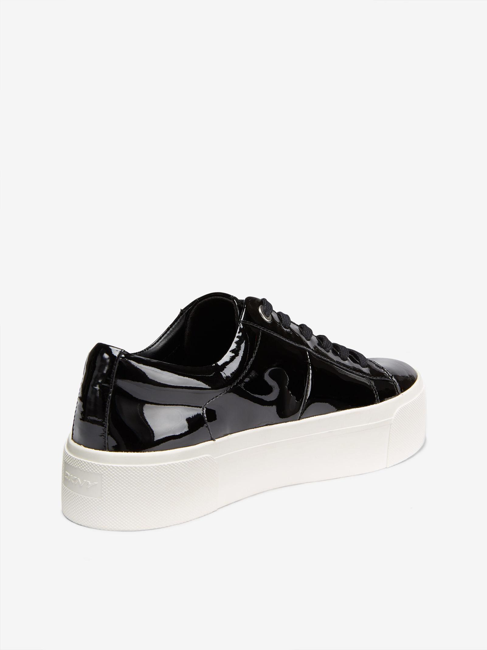 f42fa3849dd Lyst - DKNY Bari Patent Platform Sneaker in White