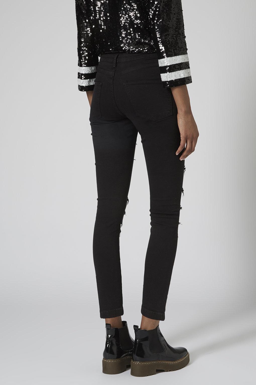 topshop petite moto black ripped jamie jeans in black lyst. Black Bedroom Furniture Sets. Home Design Ideas