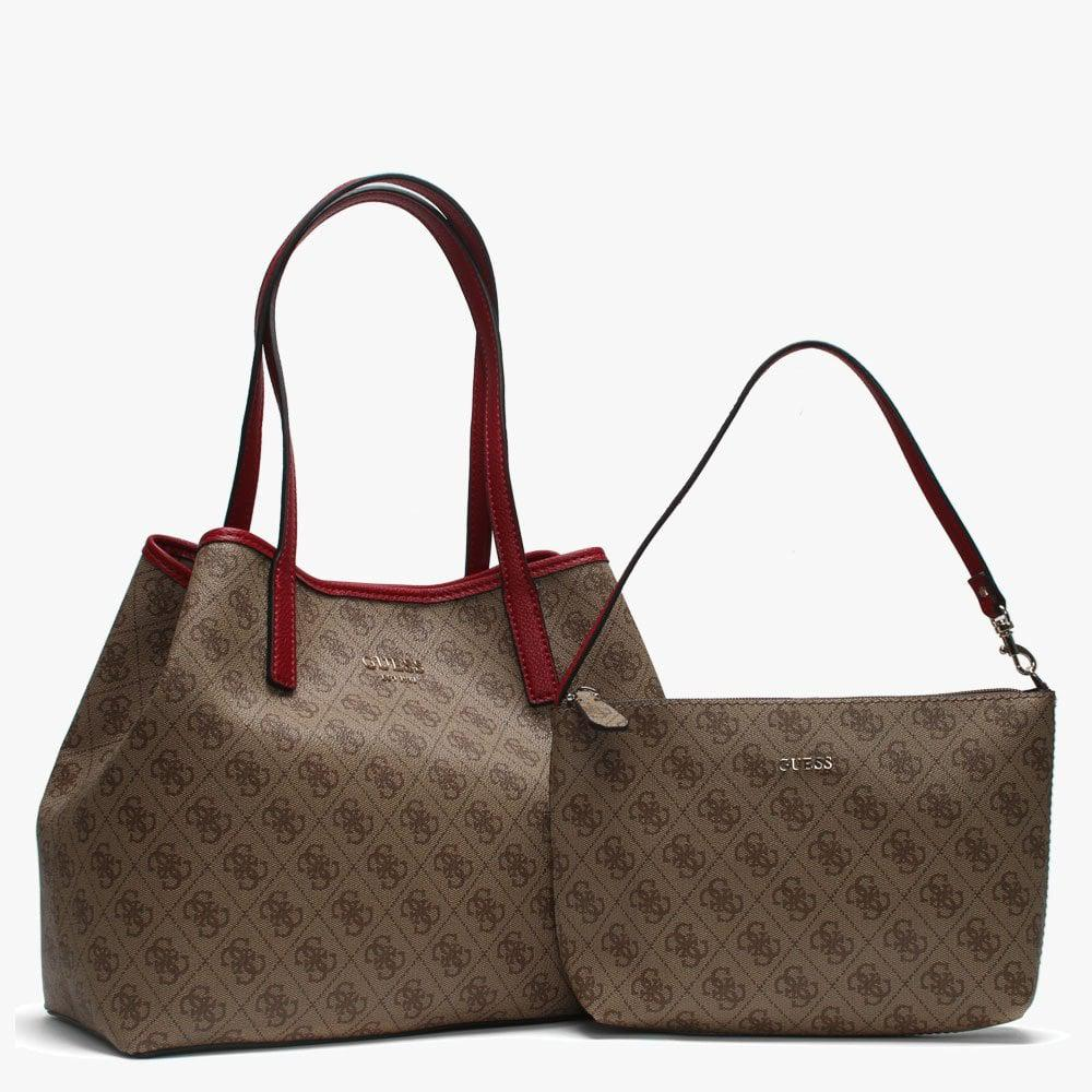 skörda Kör klo  Guess Vikky Brown Signature Logo Coated Canvas Tote Bag - Lyst