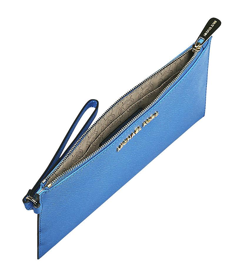 michael michael kors jet set travel pouch in blue jet lyst. Black Bedroom Furniture Sets. Home Design Ideas