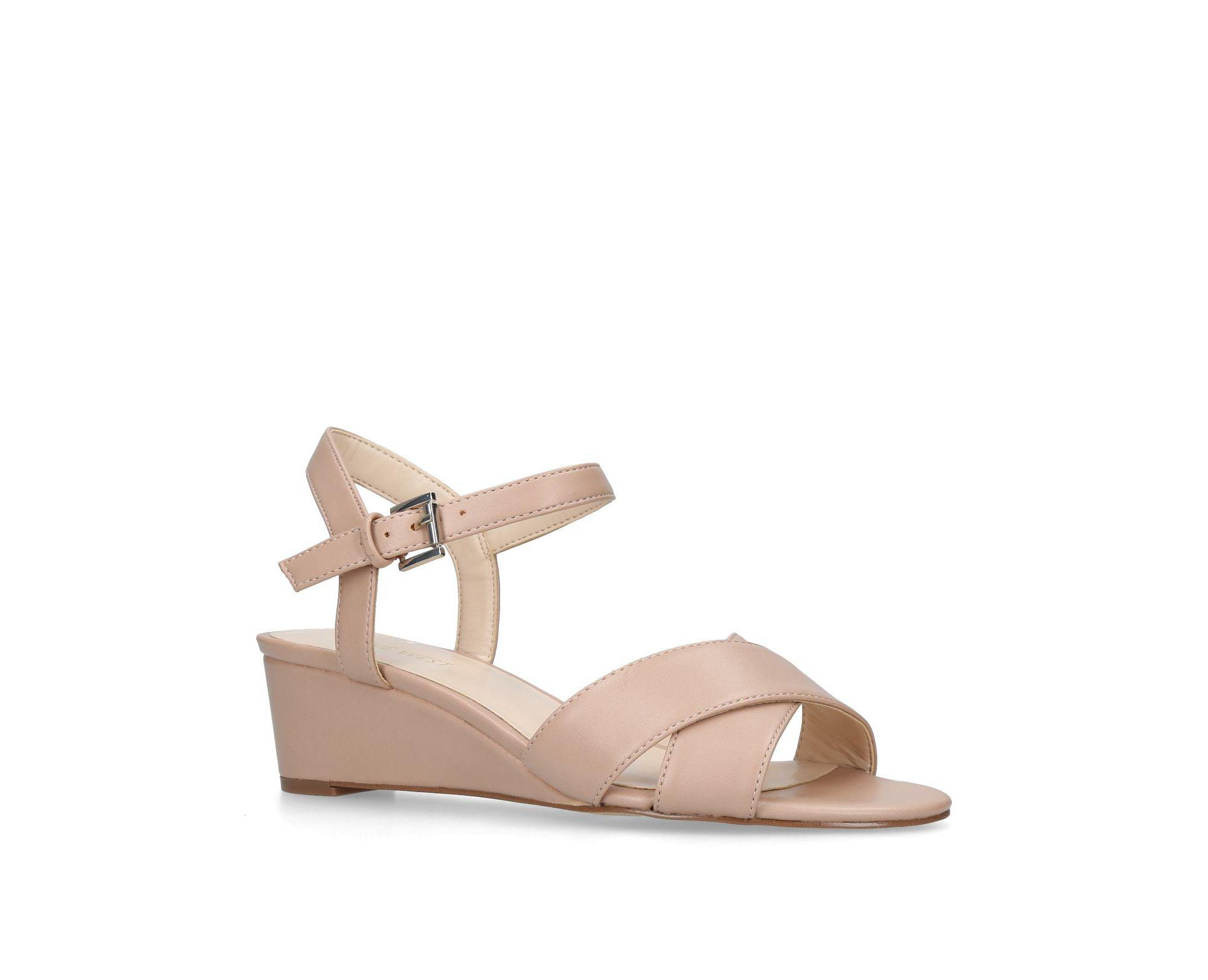 dddfc67e4464 Nine West Nude  lucyme  Low Heel Wedge Sandals in Natural - Lyst