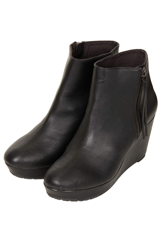ef54785b0f5 Lyst - TOPSHOP Alba Side Zip Wedge Boots in Black