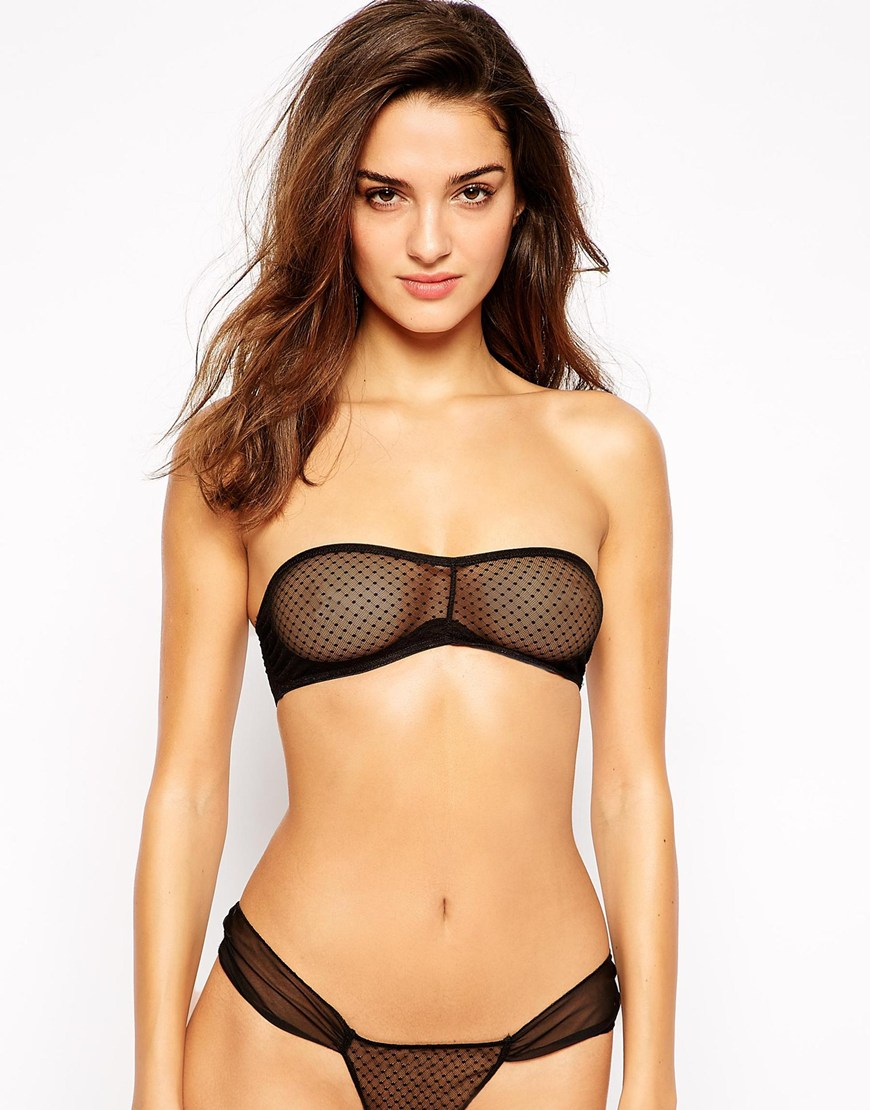Diamonte bandeau crop Straight cut design Zip closure 60% Rayon 35% Nylon 5% Spandex *Please note, each garment is uniquely made therefore the arrangement of the diamontes may differ slightly. Styled with the Aurora pant. Bruna wears a size XSHeight: cm Waist: 58cm Hip: 86cm.