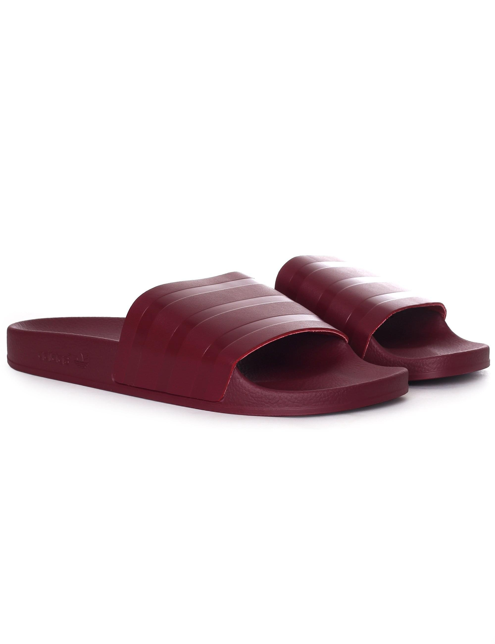 e912ac07d adidas Men s Adilette Slides Collegiate Burgundy in Purple for Men - Lyst