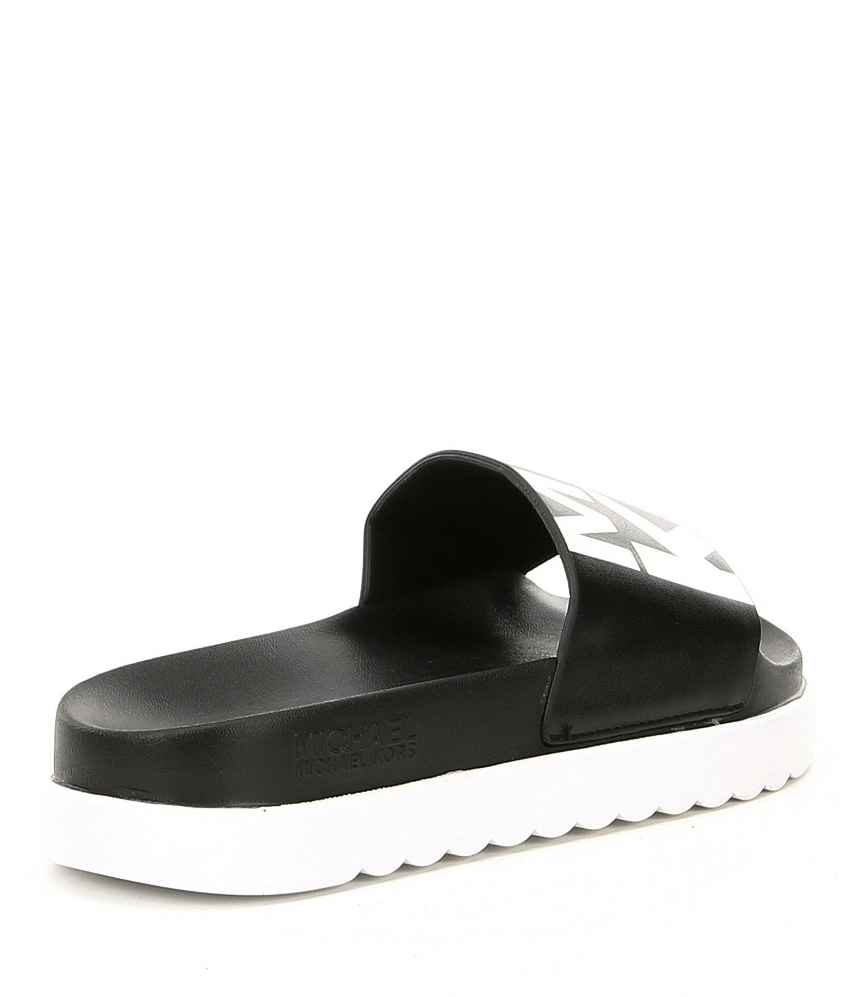 af2a8e7e4195 Lyst - MICHAEL Michael Kors Tyra Logo Slide Sandals in Black