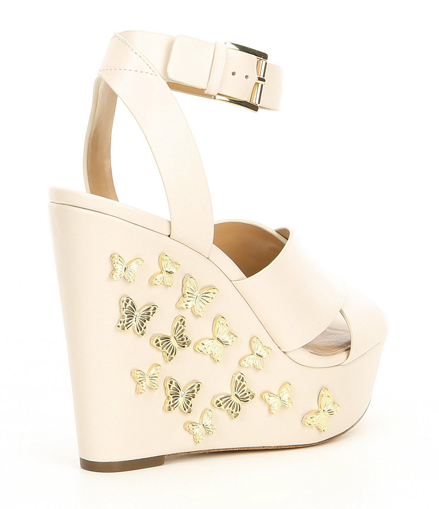 0eadf0dafb5 MICHAEL Michael Kors - Natural Lacey Leather   Butterfly Charm Wedge Sandals  - Lyst. View fullscreen
