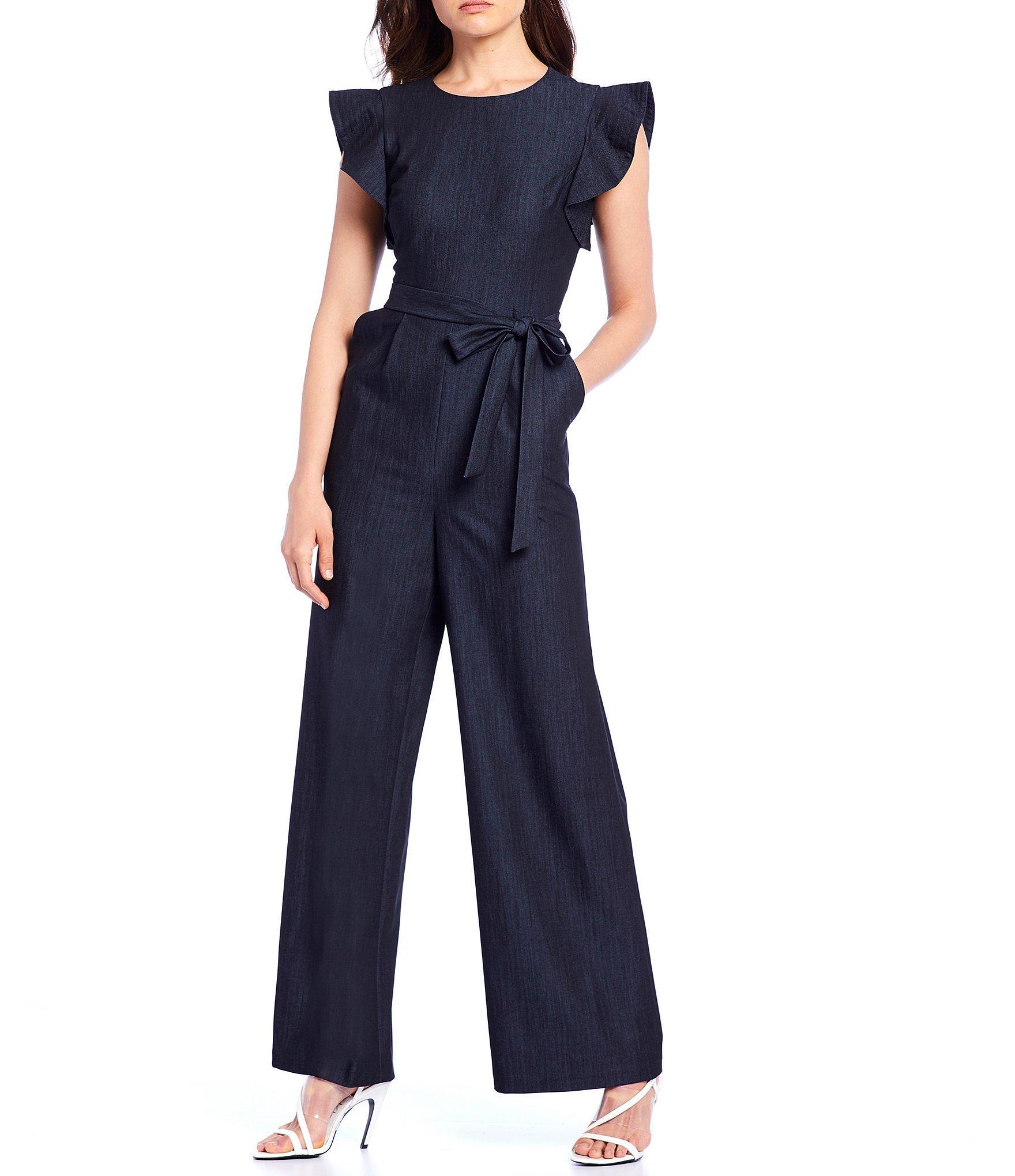 4a38f224cccf Calvin Klein Denim Ruffle Trim Tie Waist Jumpsuit in Blue - Save 1 ...