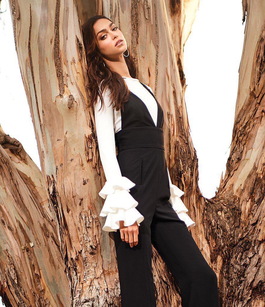 0dbe59d974b0 Lyst - Gianni Bini Amy Deep V Jumpsuit in Black