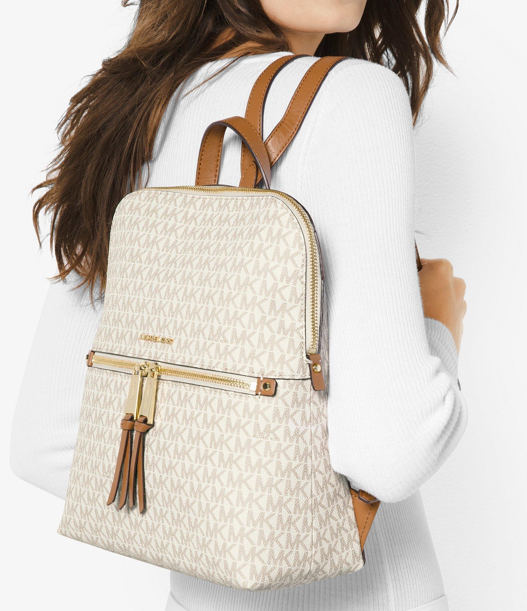 f411cd52b4d0c Lyst - MICHAEL Michael Kors Rhea Signature Zip Slim Backpack