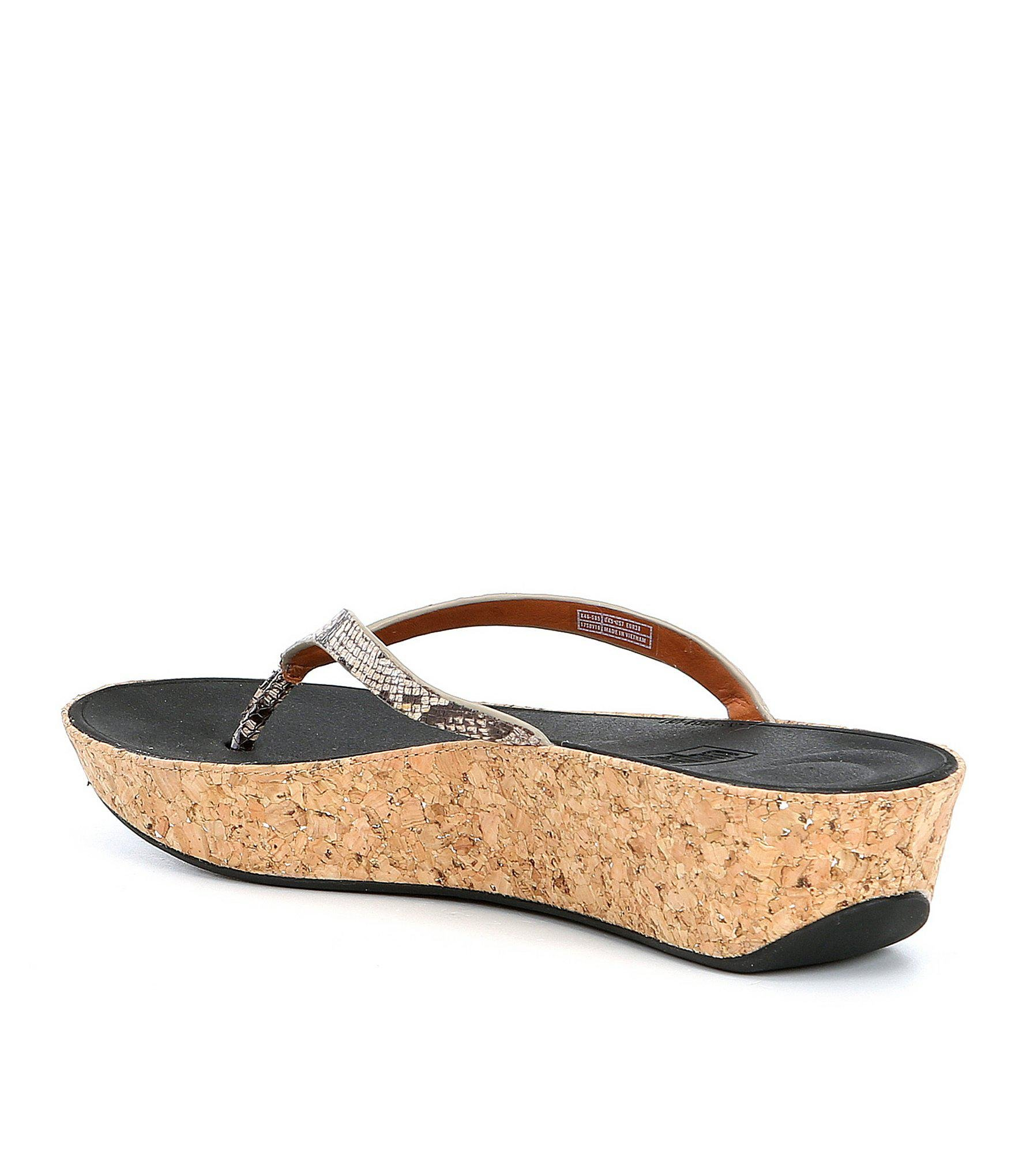 7fec44d7826 Lyst - Fitflop Linny Snake Print Thong Wedge Sandals