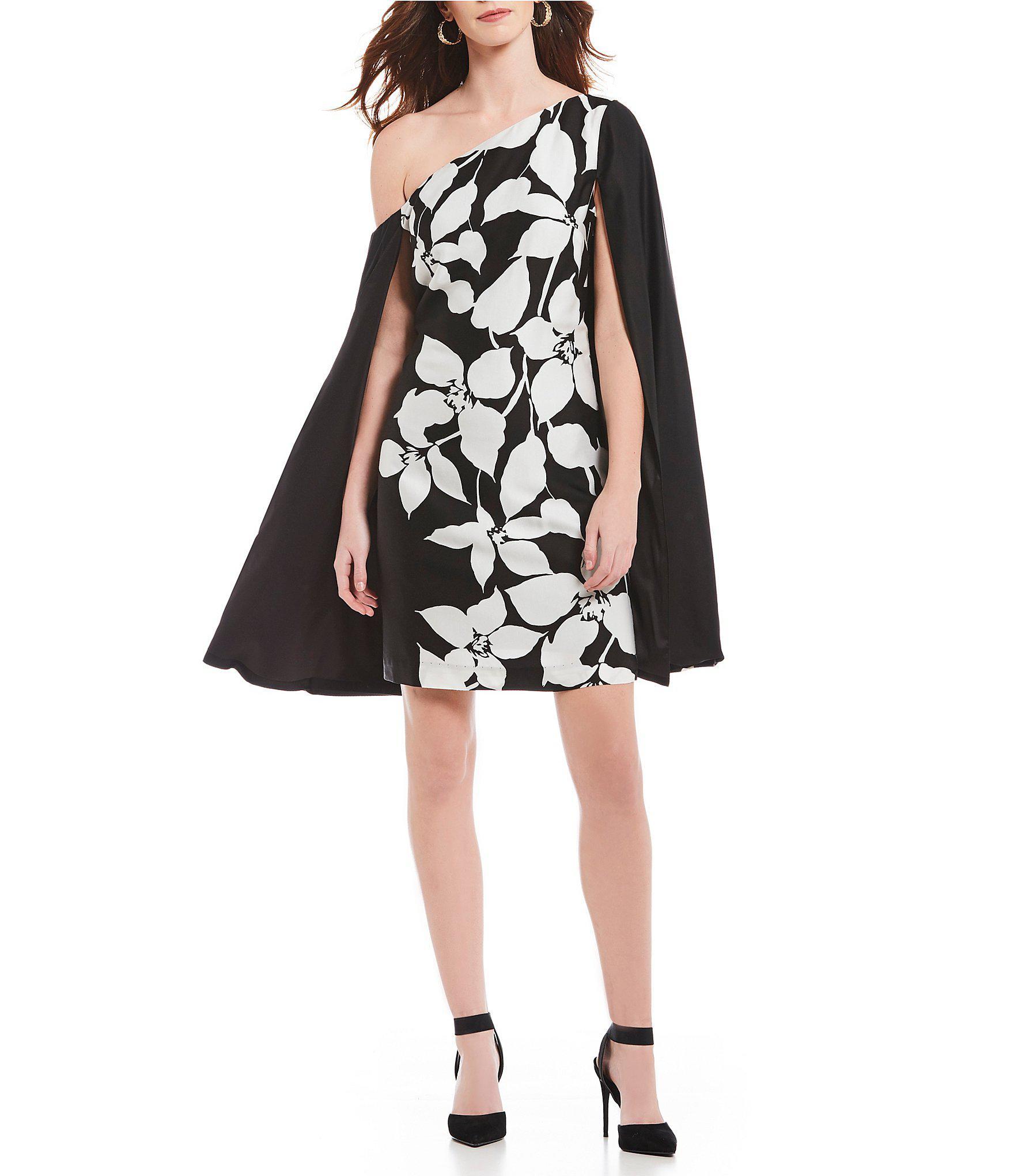 655e5a0ff8a Trina Turk Classic Floral Print One Shoulder Cape Dress in Black - Lyst